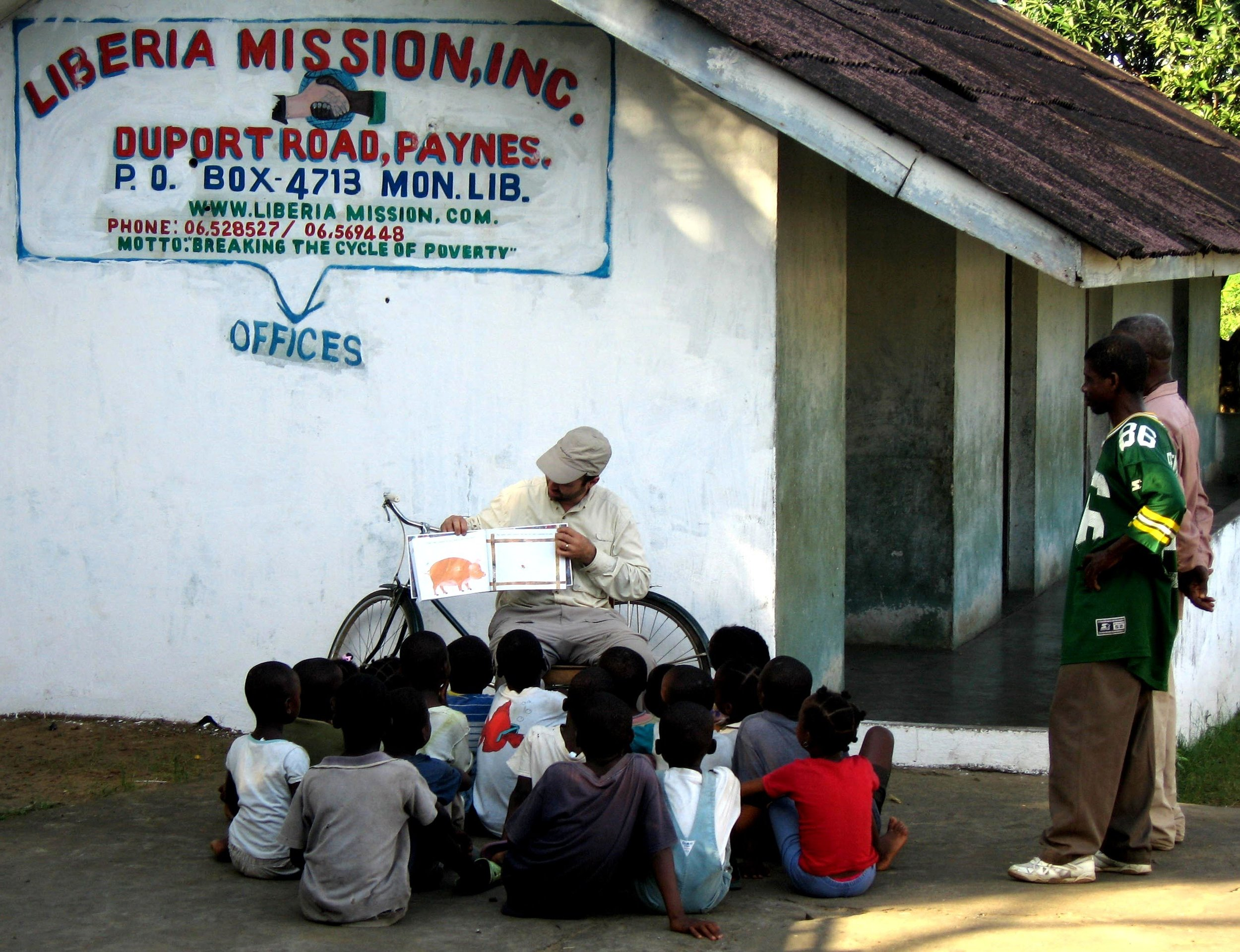Our founder, Dave, reading to our early students.
