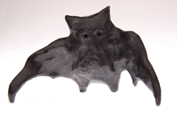 """two faced bat  , 2009 cast bronze filled with lead  3 x 4 3/4 x 2 3/4"""""""