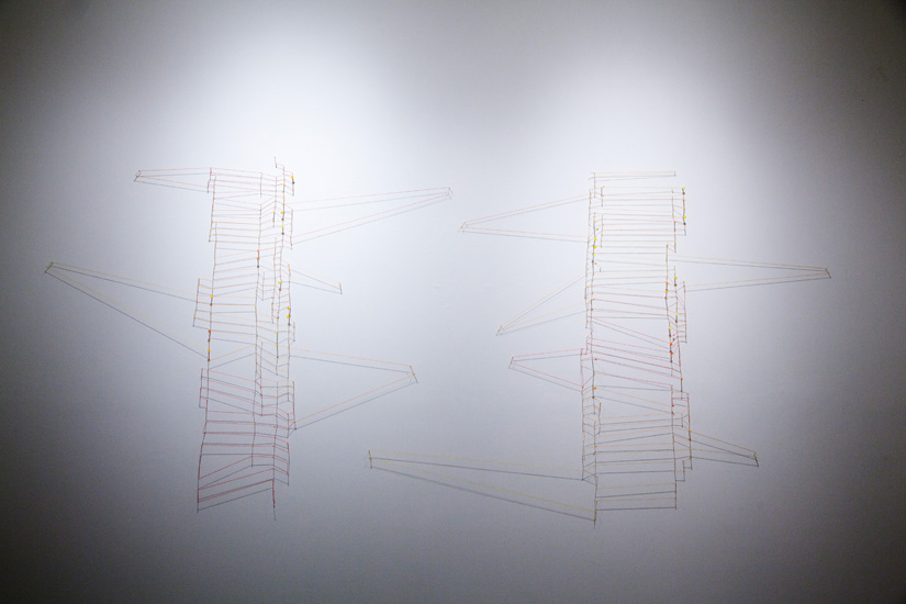 """shadow drawing (red-orange-yellow) , 2010 nails, acrylic, thread and shadow on wall 62 x 118"""" (dimensions variable)"""