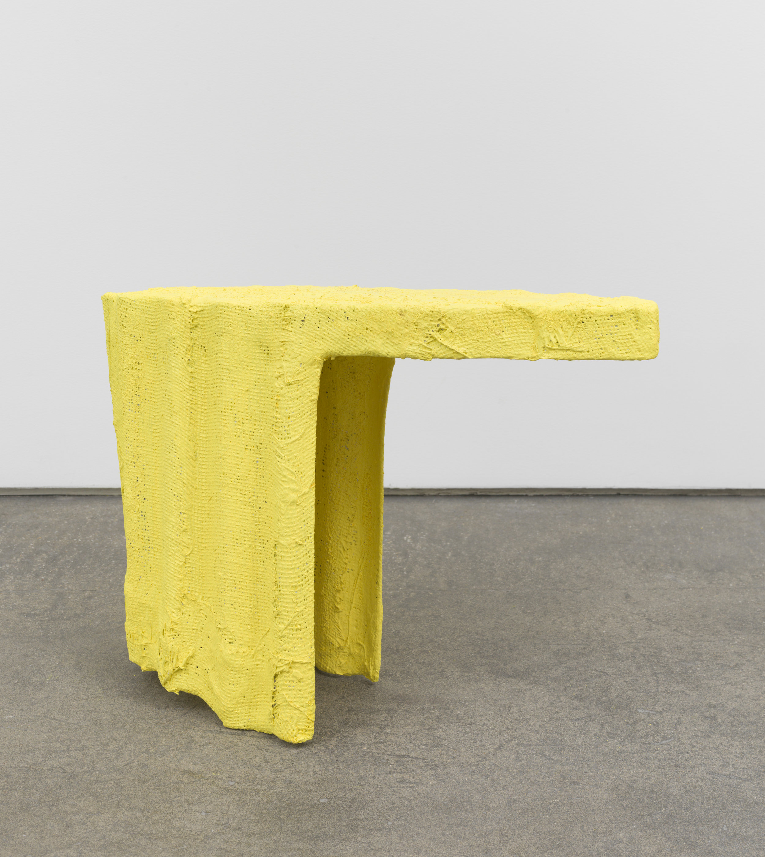"""Woman with a Yellow Scarf , 2017  Pigment, plaster, burlap, plastic  20 x 26 x 9"""""""