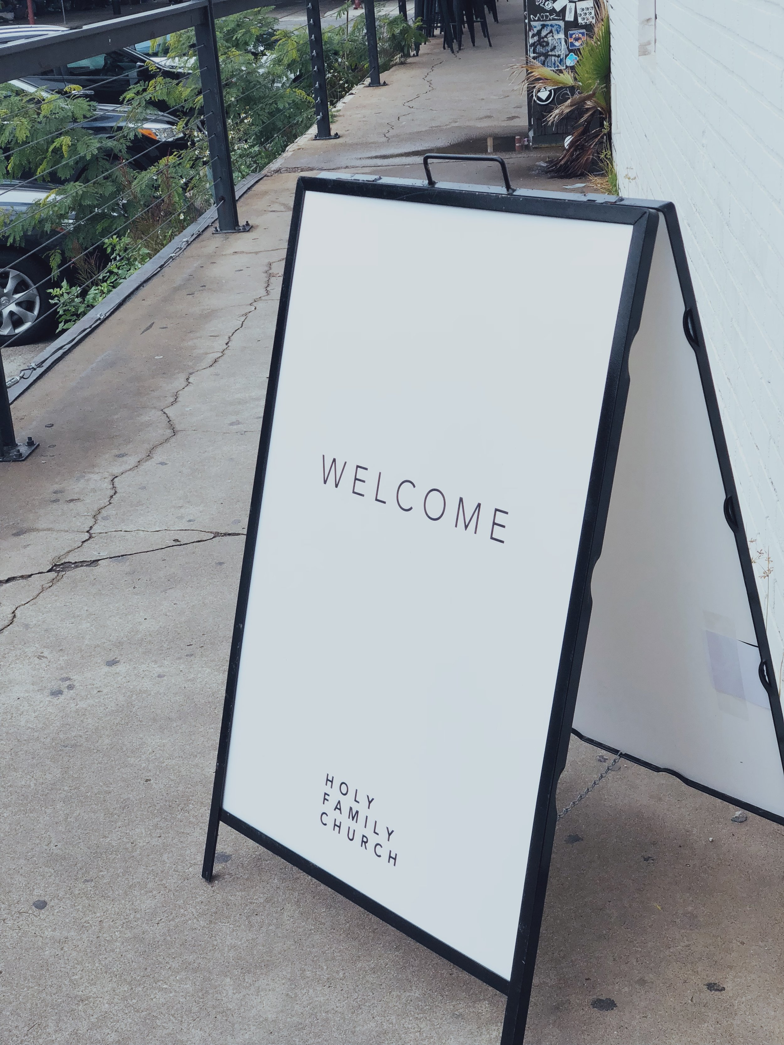 PARKING - Look for the Holy Family Church sandwich boards outside of the doors on Commerce Street.