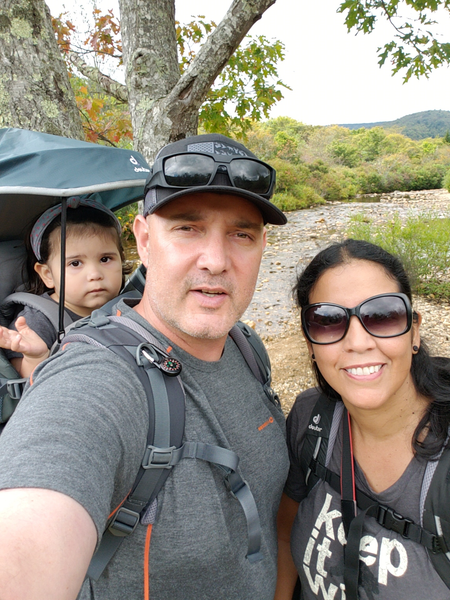 Family hike using a Deuter baby carrier.