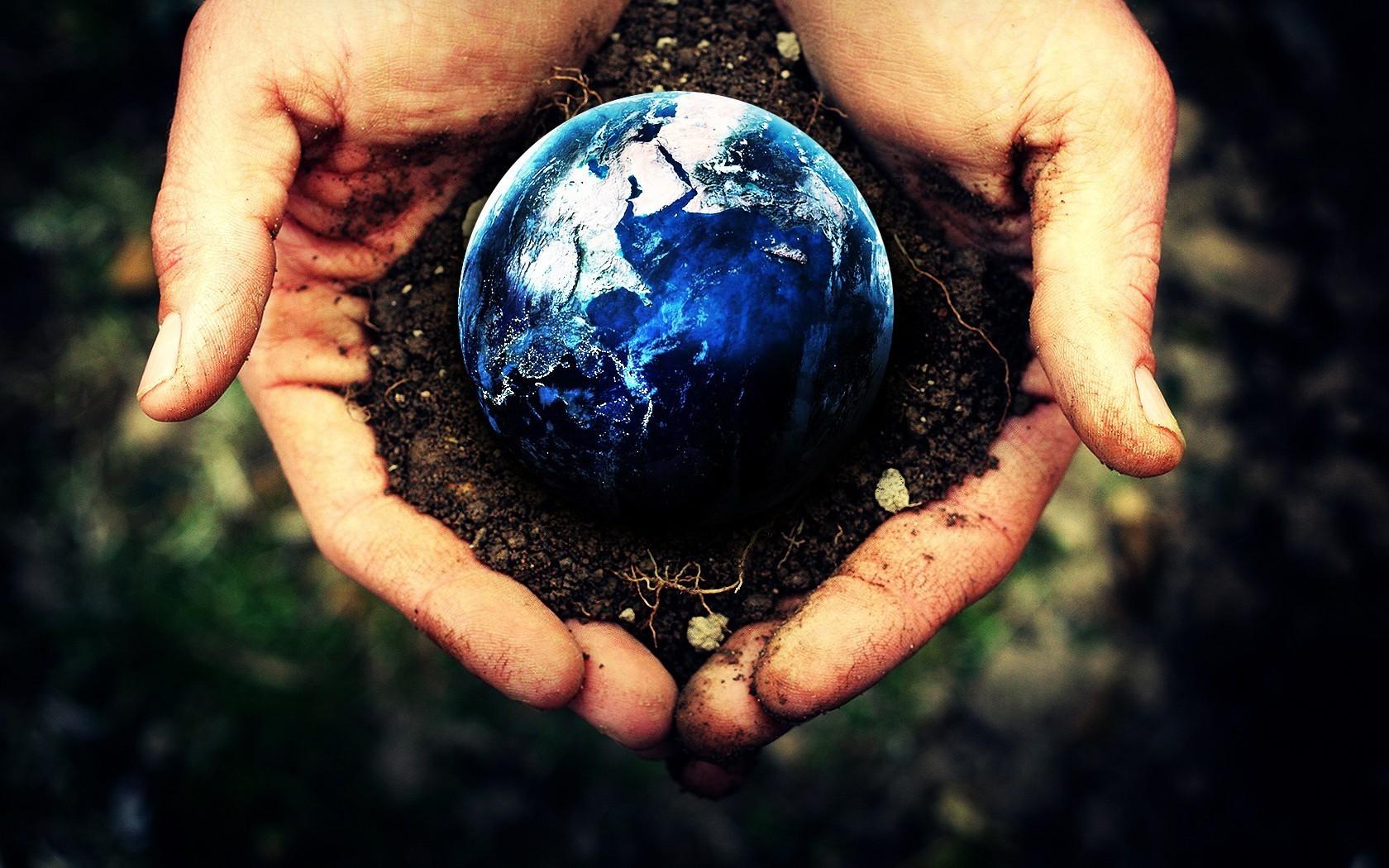 162135-Earth-planet-hand-photo_manipulation-dirt.jpg