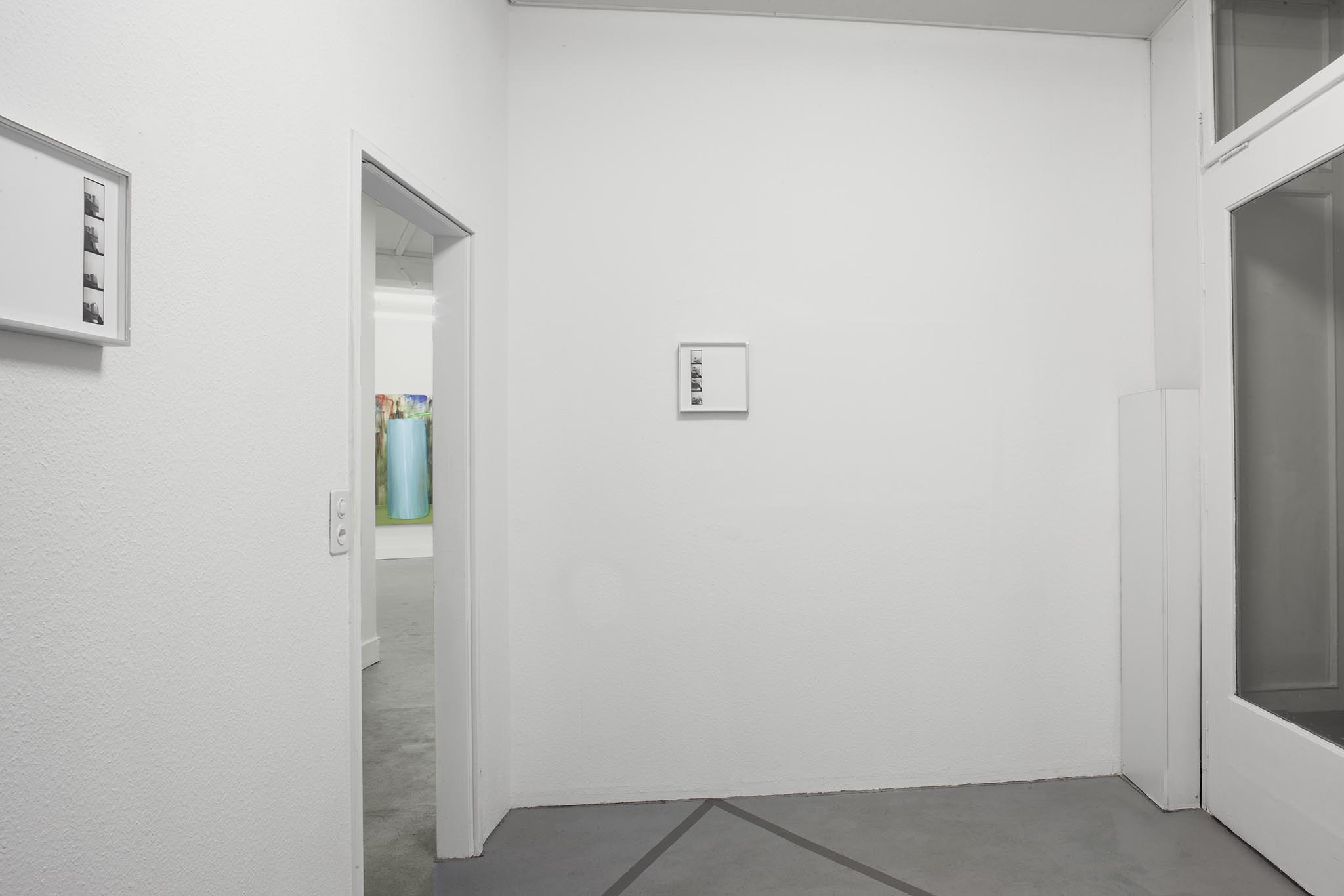 Vittorio Santoro,  Four Speakers' Corners, I , 2014, four photo booth stripes, each framed in a welded aluminum frame (25x25 cm), silver-grey adhesive tape on floor. Dimensions vary with installation Photo: Christoph Oeschger