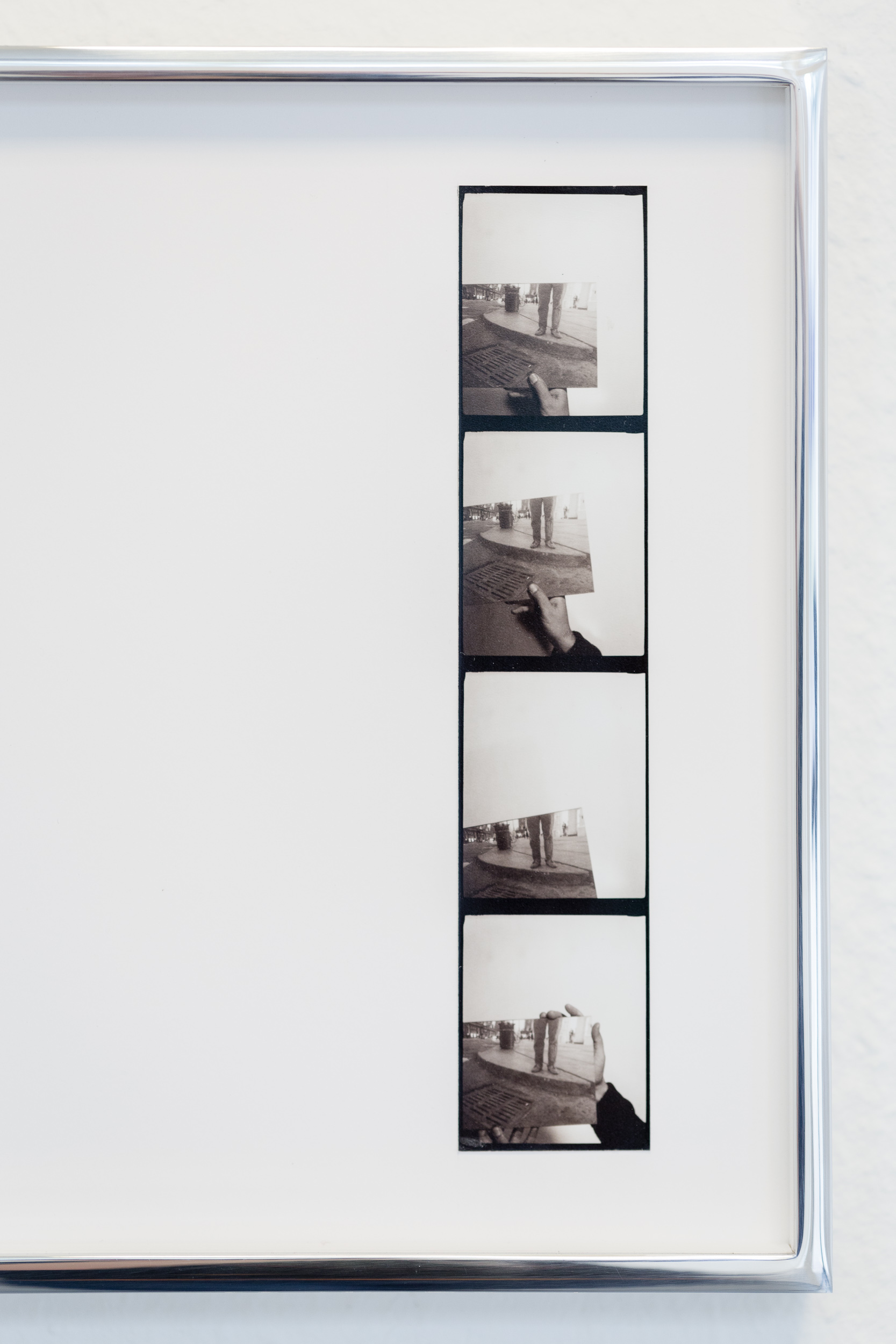 Vittorio Santoro,  Four Speakers' Corners, I , (detail), 2014, four photo booth stripes, each framed in a welded aluminum frame (25x25 cm), silver-grey adhesive tape on floor. Dimensions vary with installation  Photo: Kilian Bannwart