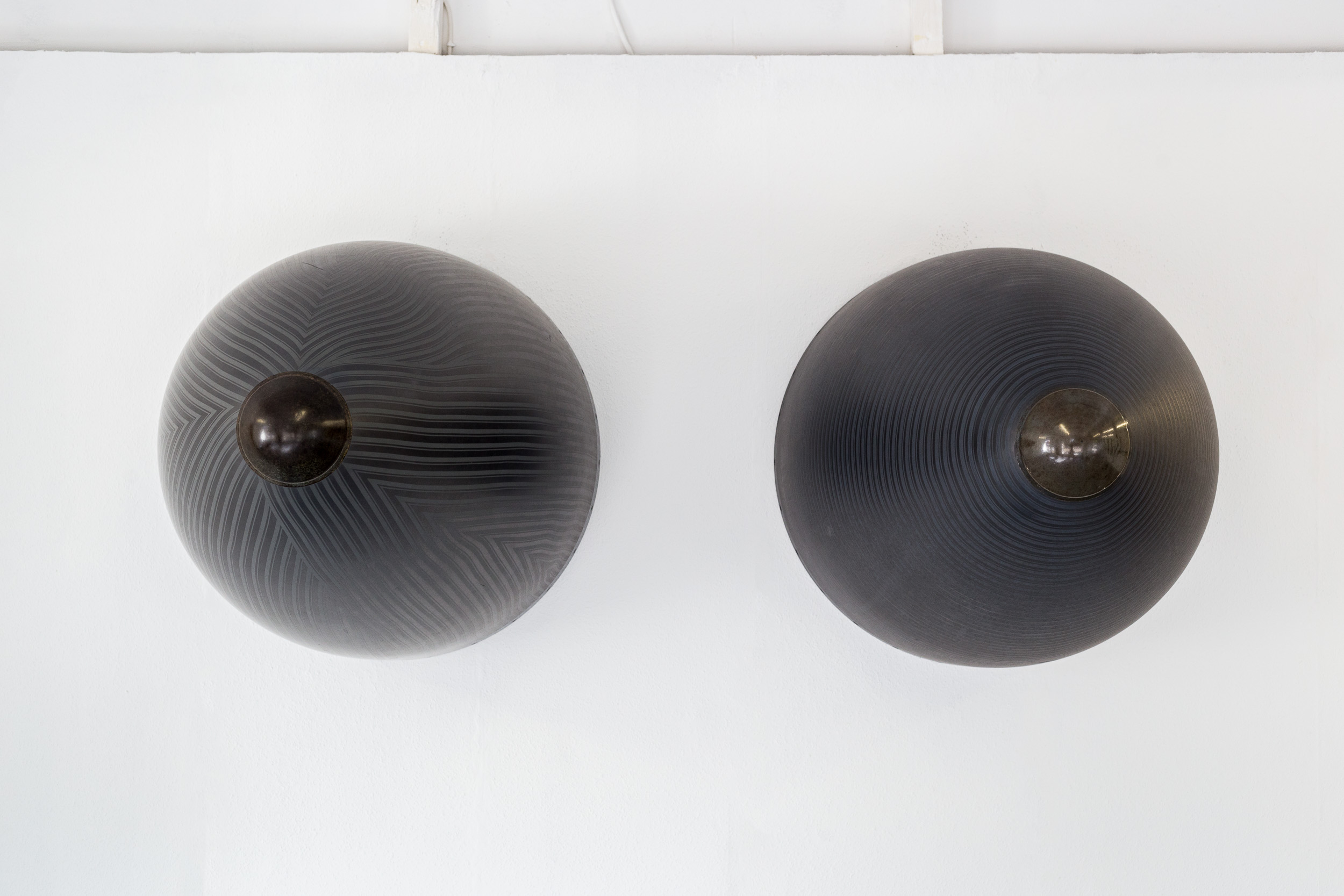 Fiona Banner,  Nose Art , 2015, harrier jump jet nose cones, graphite, 107 x 79 cm each  Photo: Kilian Bannwart