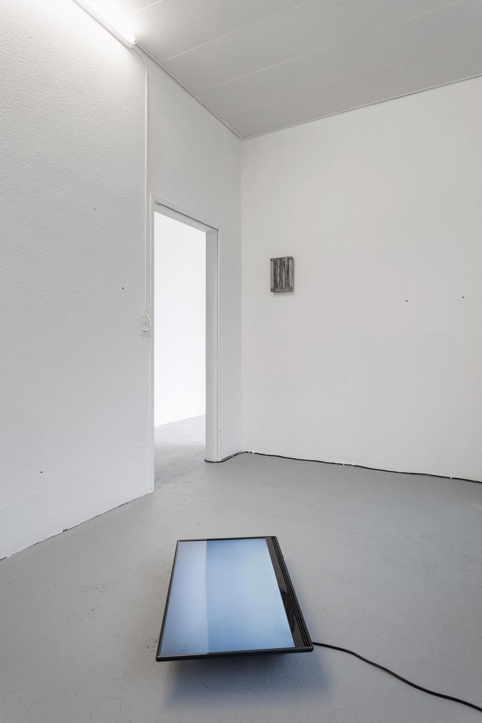 Kong Chun Hei,  Sidestep   Front:  Peeling , 2018, Video, 30:25  Back:  Parcel , 2018,Ink on paper mounted on wooden frame, 20 x 30 x 5cm  Photo: Kilian Bannwart