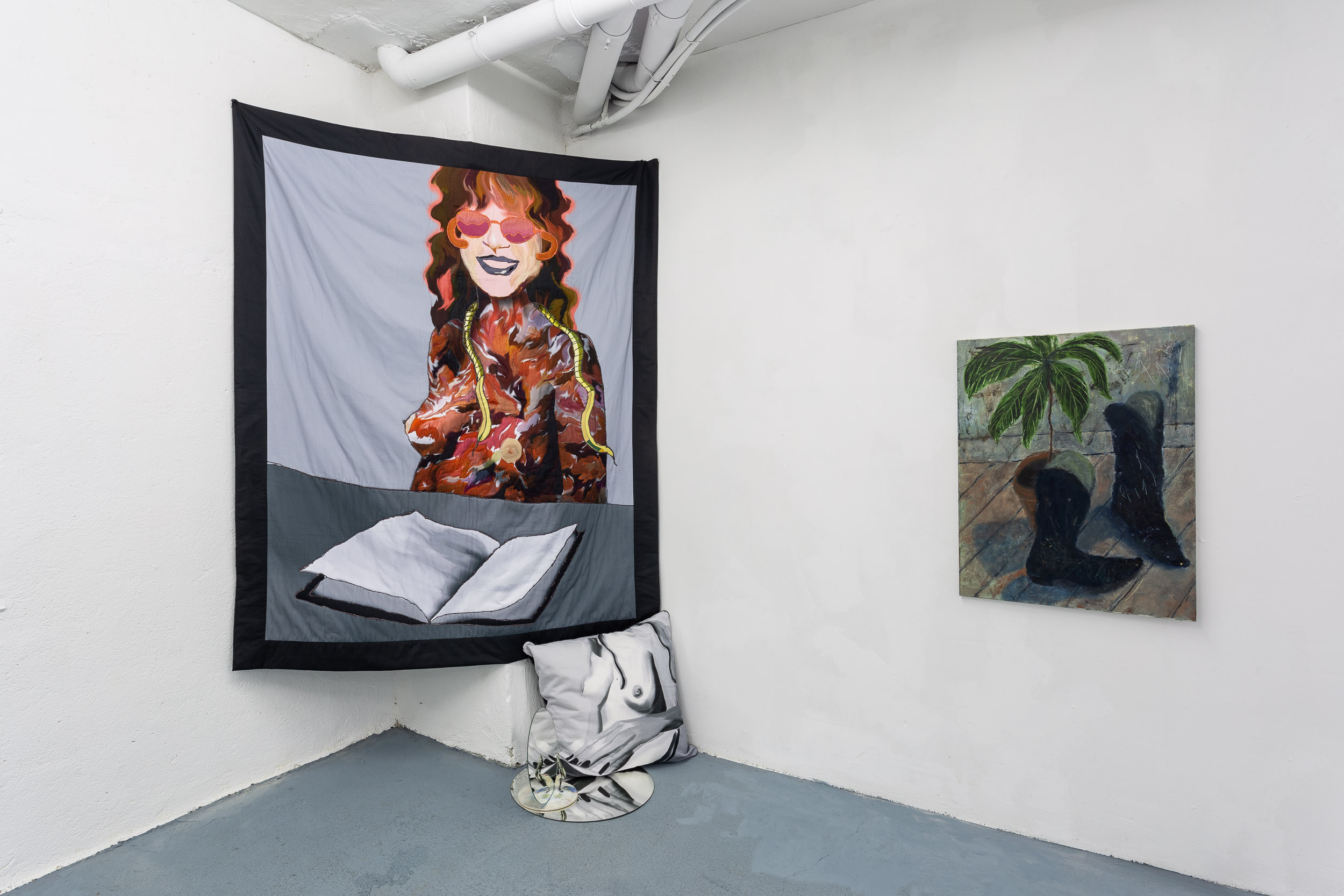 Left: Xénia Lucie Laffely,  Chase the pattern (Quilt for Judy Chicago),  2018, embroidered quilt, 180 x 160 cm I  No milk for u bitch , printed cotton, 60 x 60 cm Right: Dieter Hall,  My avocado, my boots,  1989, Oil on canvas, 80 x 60 cm,  Photo: Kilian Bannwart