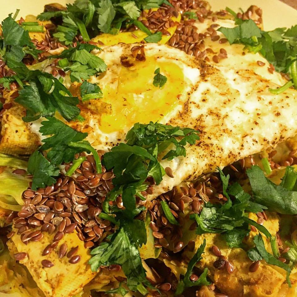 Curry tofu and eggs over cauliflower.