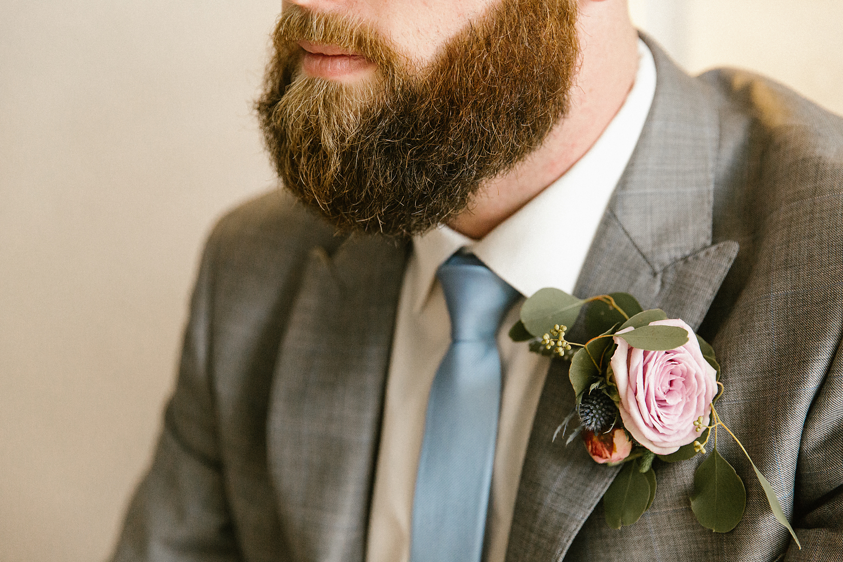 Buttonhole by Francesca's Flowers. Photography by Poppy & Sage Photography.