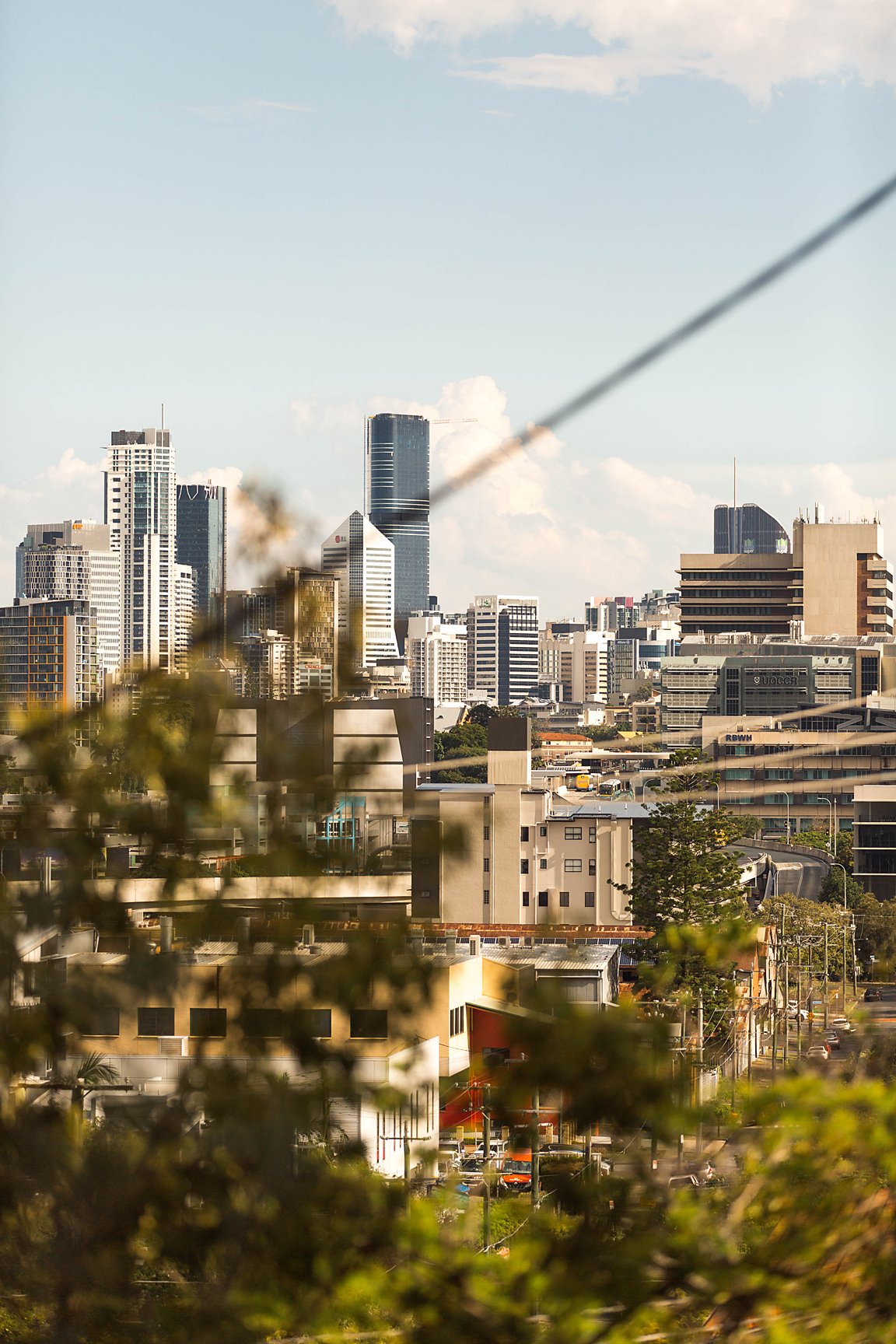 Brisbane soaking up the afternoon light; the view from our home hence the suburban addition of the power-line! We are incredibly grateful for our city - the perfect (for us) hometown to raise a family. (Poppy & Sage Photography)