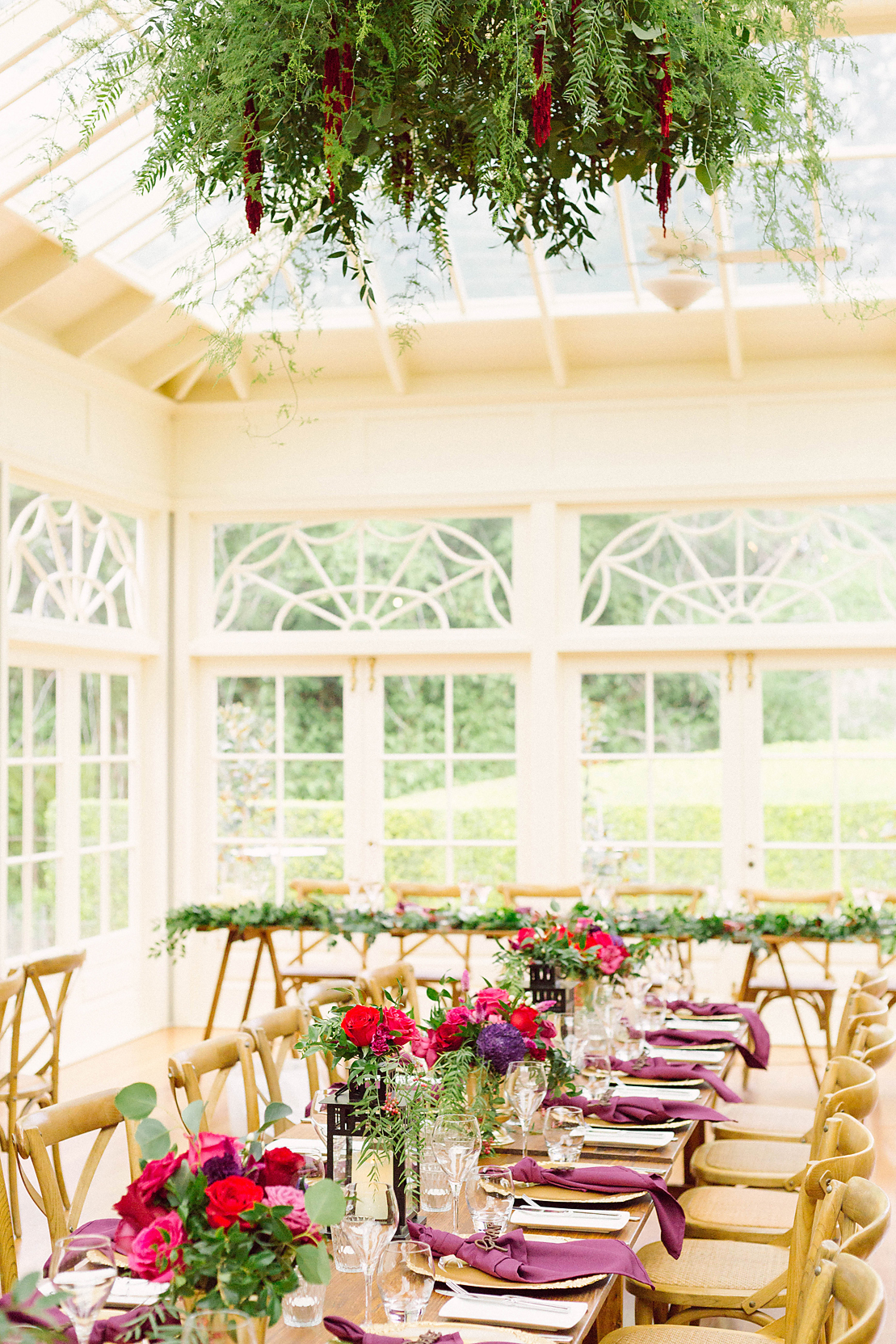"One question that has popped up in client consultations is, ""Can you capture the greenery outside of our reception venue from the inside?"" Yes, we can. (Image by  Poppy & Sage Photography .)"