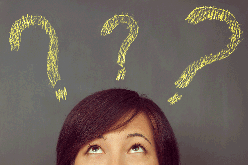 depositphotos_46306449-stock-photo-woman-looks-at-question-marks.jpg