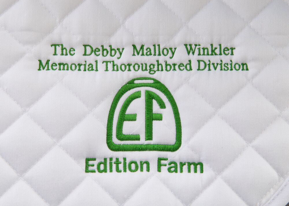 Competitors receive a saddle pad
