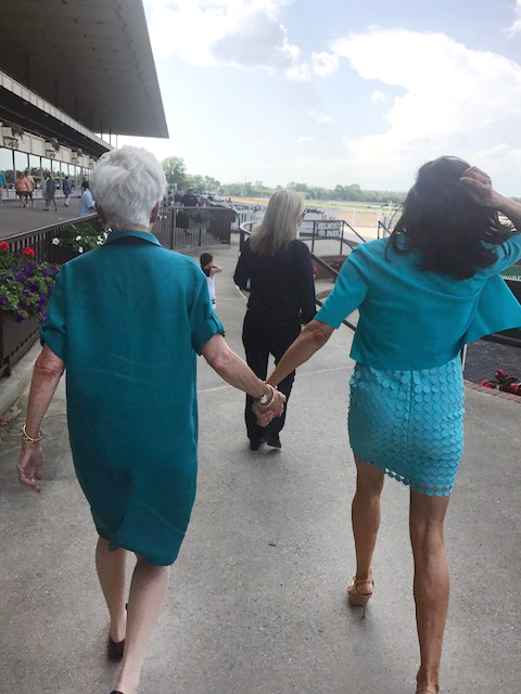 Vivien and Sheila walking to the winners circle with trainer, Linda Rice to greet Silly Sister!