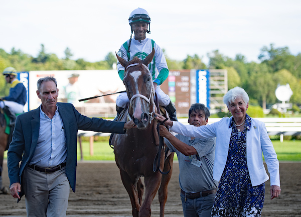 Vivien Malloy leads Riendo to 12th race winners circle.jpg