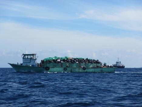 """A barge bringing waste to be burned to Thilafushi, nicknamed """"Trash Island."""""""