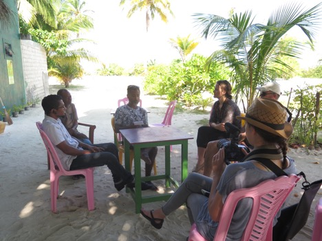 Hydrous team speaking to a council member on Bodufolhudhoo.