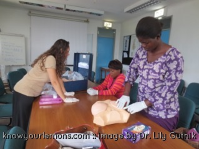 Dr. Lily Gutnik supervising the training of local laywomen.