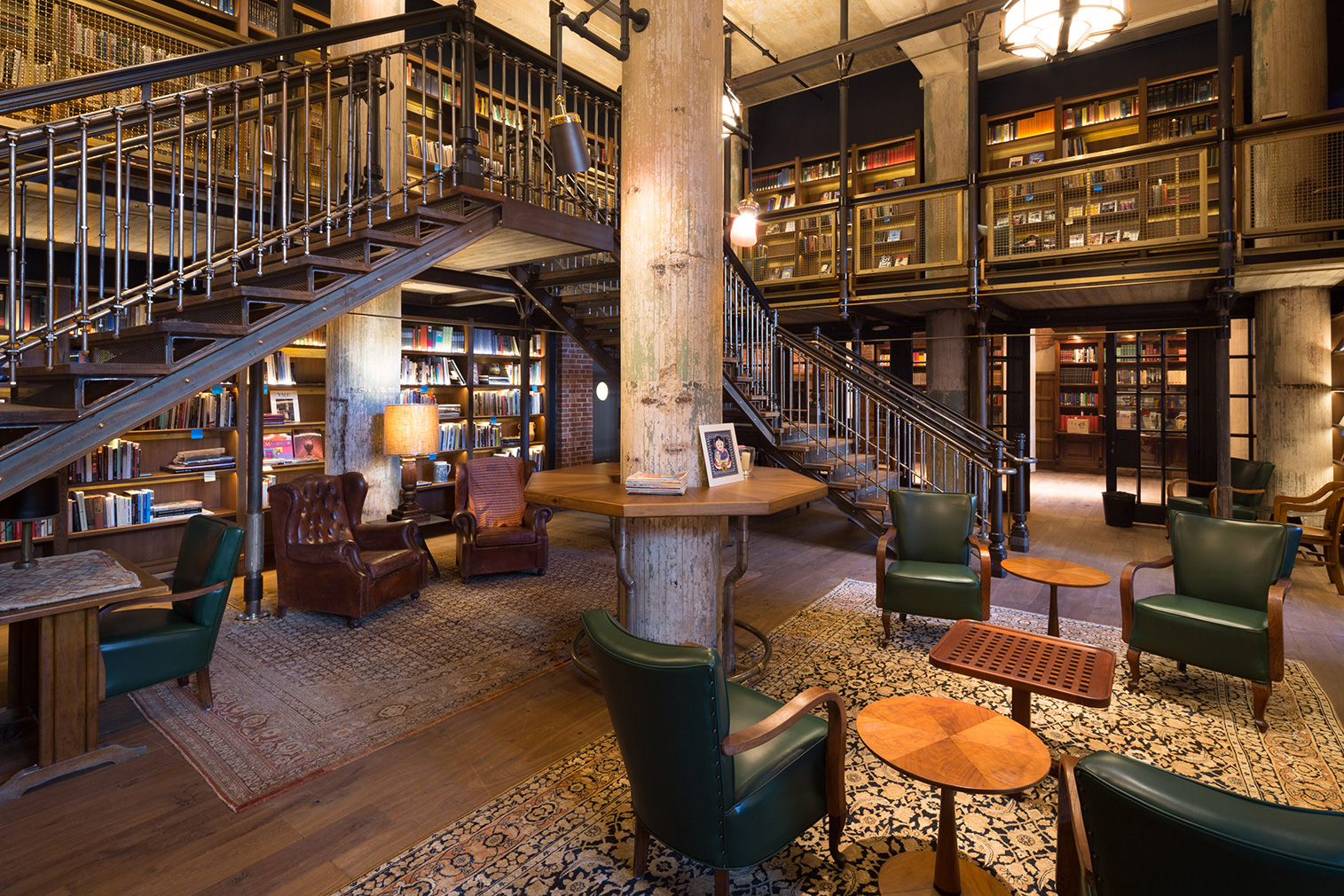 The library, where guests are greeted with a complimentary margarita. [Photo Source:  The Spaces ]