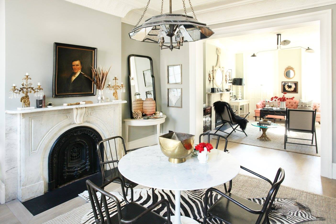 Trying to capture this eclectic feel in your own apartment or home? Go antique shopping! Mixing in antique paintings, accessories and furniture makes a space so much more interesting than using all squeaky clean West Elm or Ikea.