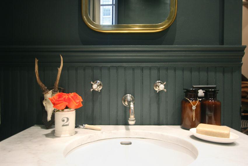 One of my favorite bathroom vignettes. So masculine...then wham! Those vivid orange roses.