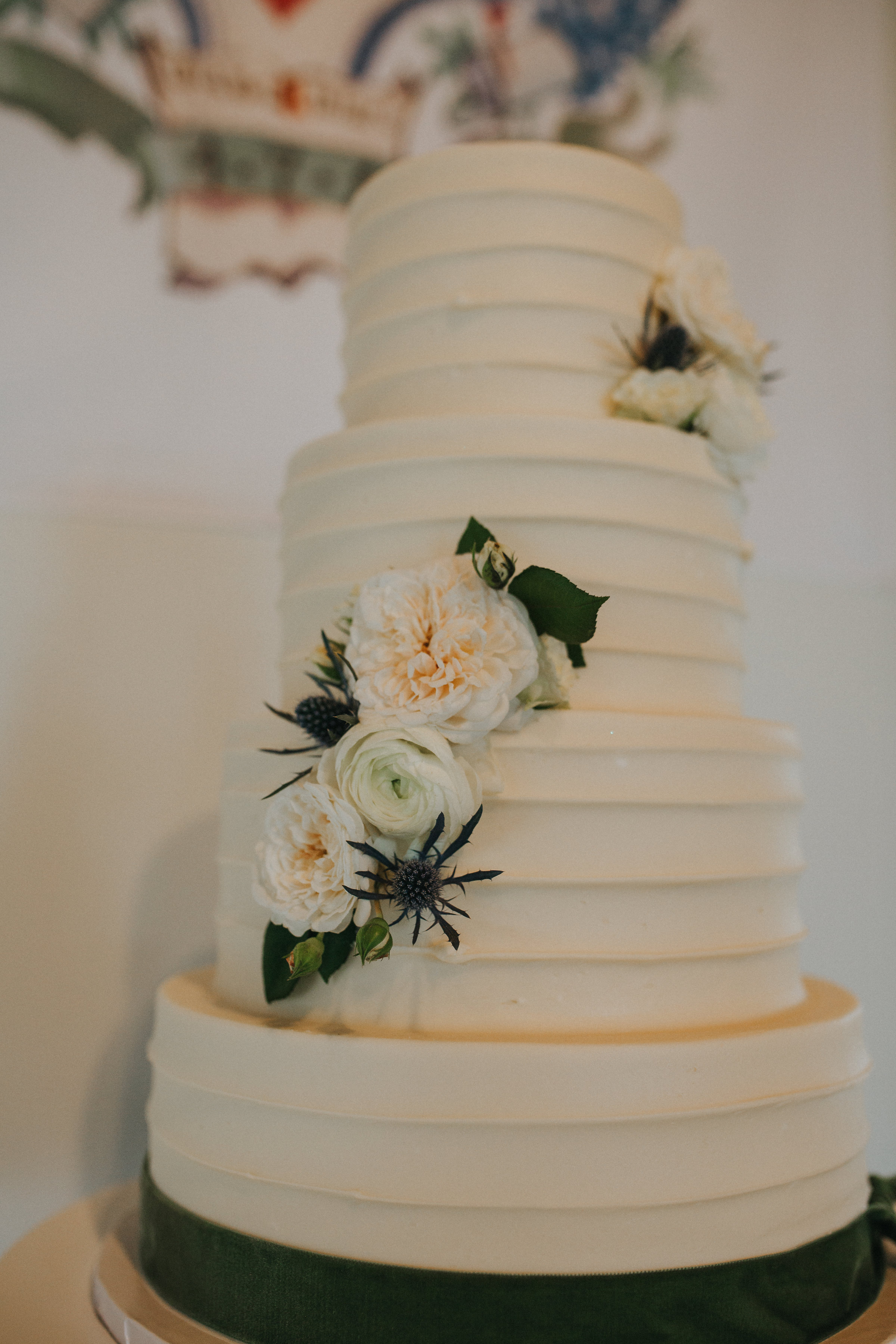 Our almond vanilla   cake adorned with velvet ribbon and florals. Cake by  Sweet Treets  out of ATX.