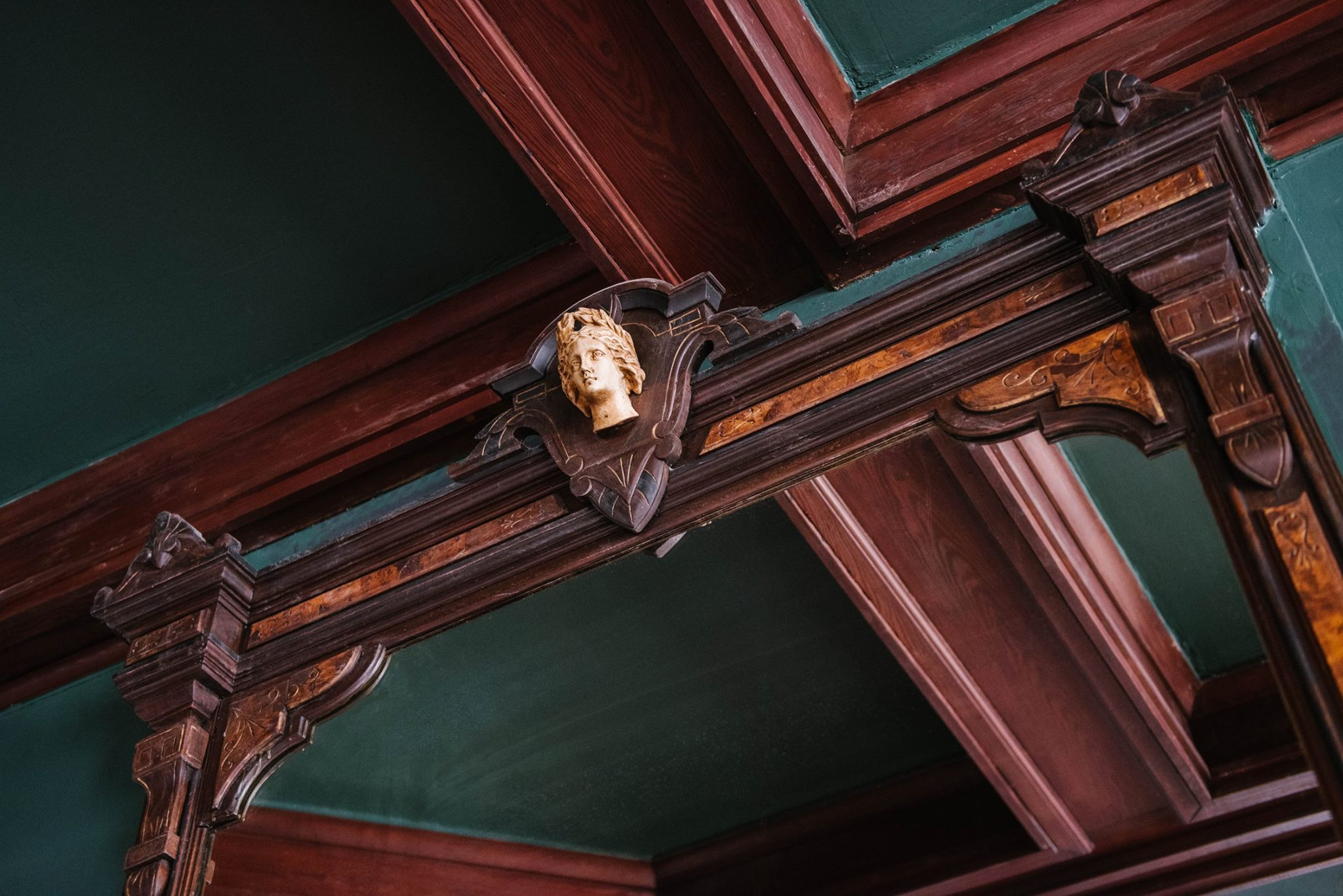 Hestia, Greek Goddess of the Hearth, is an ivory carving detail over the antique fireplace in the pub. Photo by Maggie Kloss / Source:  Carr Mansion