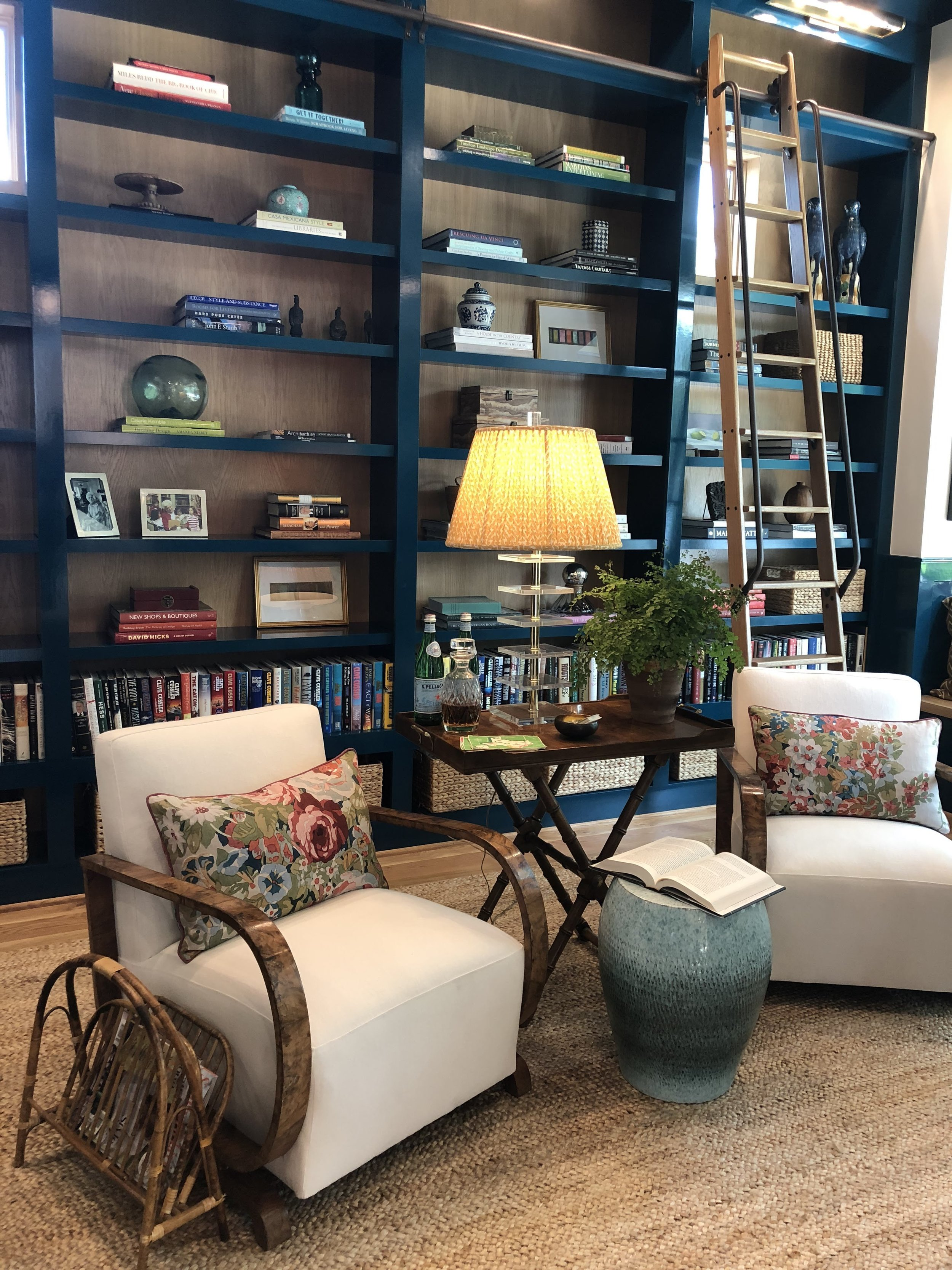 Lindsey Herod's peacock blue high gloss library, with deco chairs from Backrow Home.