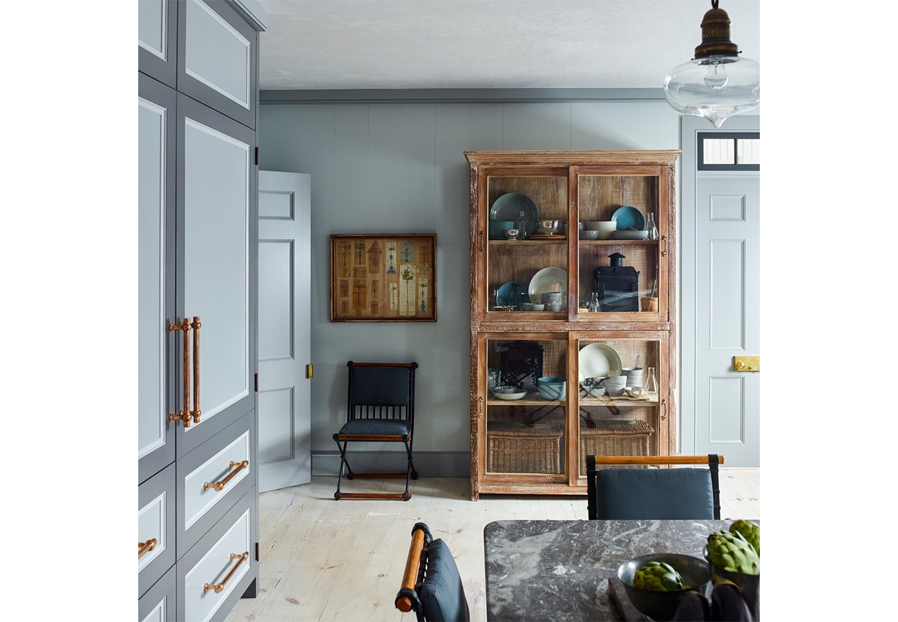 It's really hard to pick here. The two-toned cabinetry, those CHAIRS, the distressed display cabinet, the COLORS.
