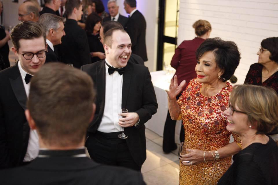Conal Bembridge-Sayers (centre) enjoys a joke with Dame Shirley Bassey
