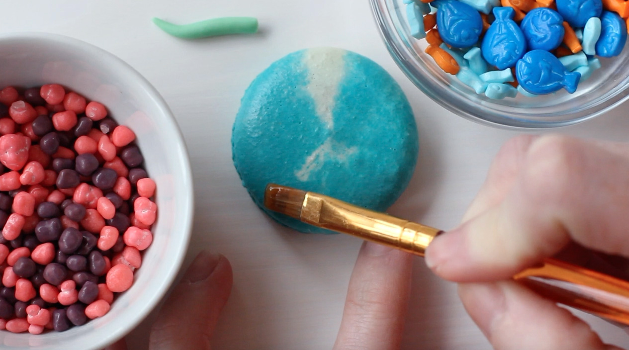 Step 2: Brush the bottom of macaron with edible glue.
