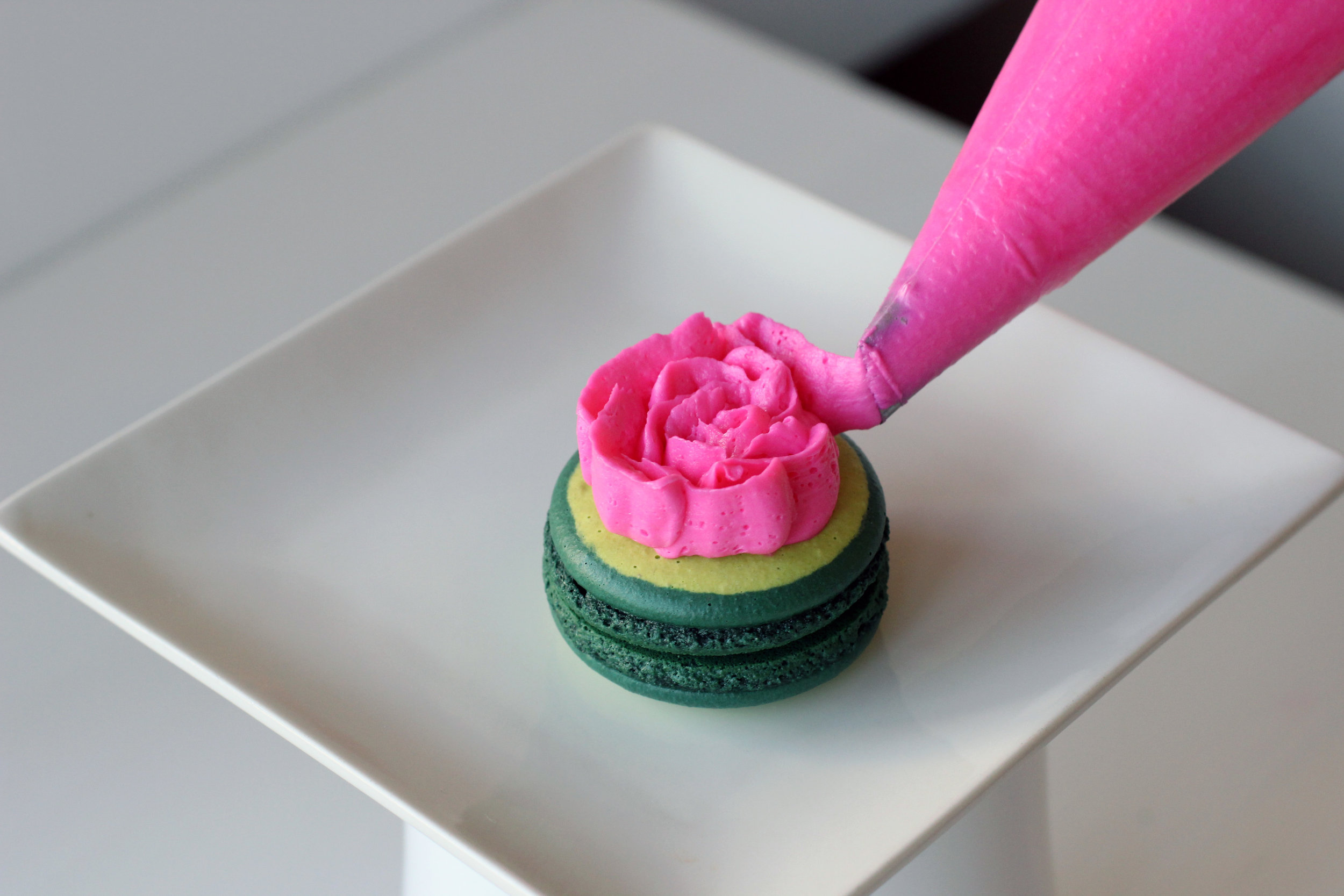 Step 2: Garnish macarons with buttercream roses.