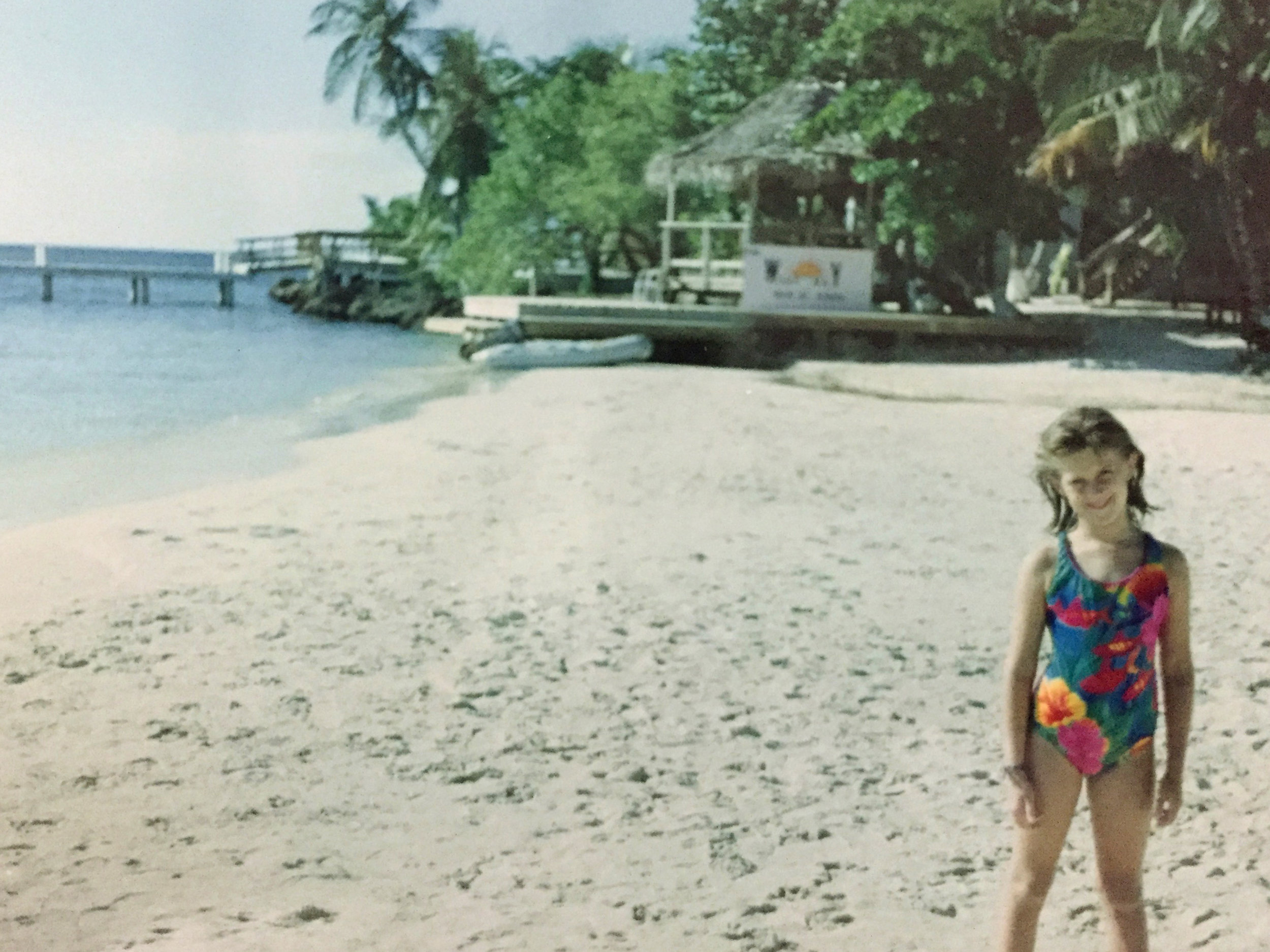 We moved to Honduras when I was 5yrs old. I am pictured above standing on the beach in West End on the island of Roatán.