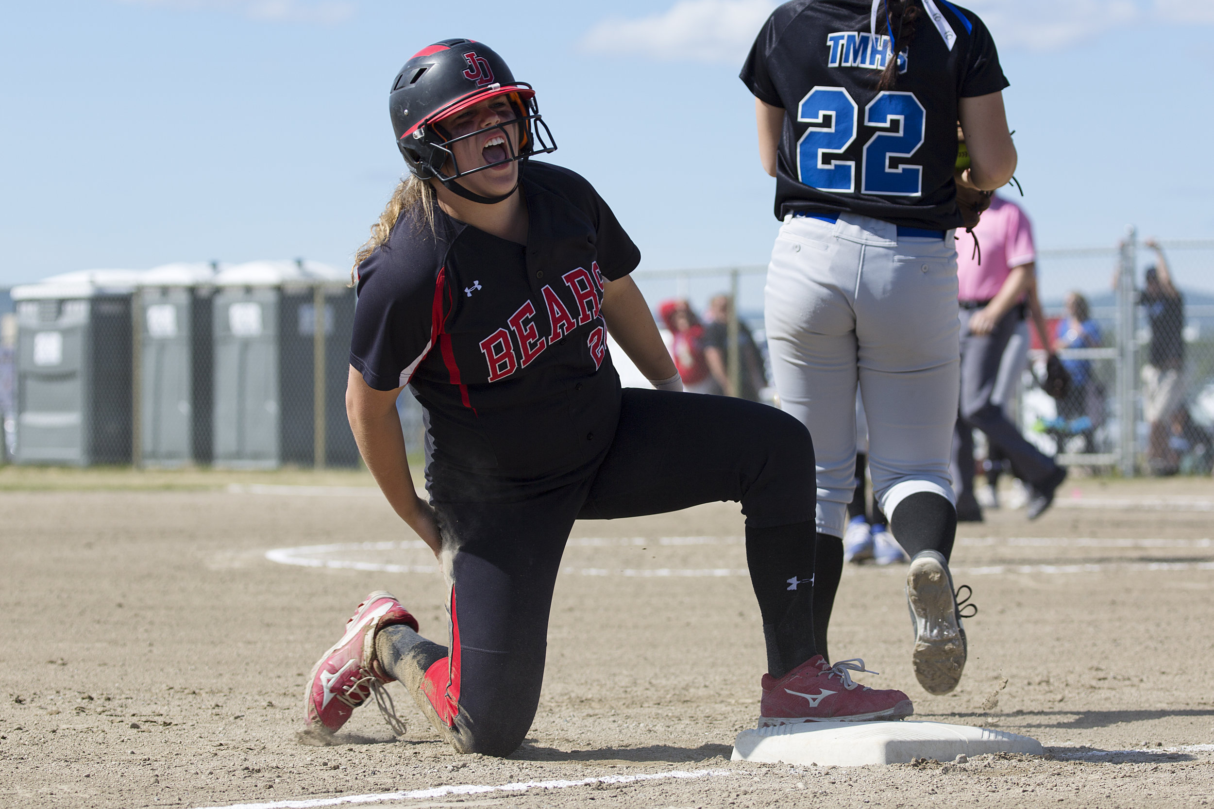 Juneau Douglas, Skylar Hickok (20) (left) yells out in pain after sliding safely onto third base in the finals against Thunder Mountain for the State Championship Softball game on Saturday, June 3rd in the South Davis Park Complex in Fairbanks, AK. Sarah Manriquez/ Juneau Empire
