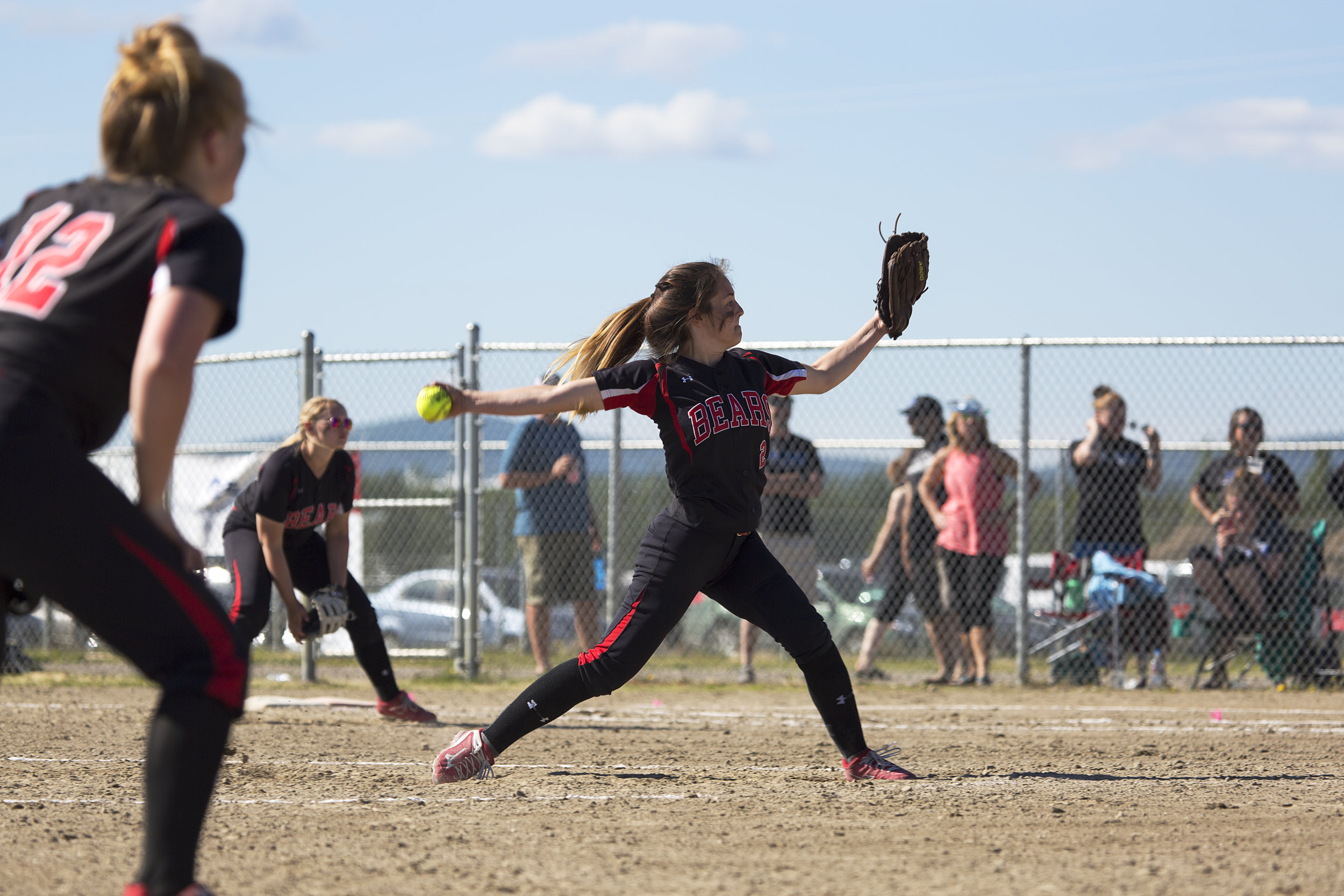 Juneau Douglas, Elisa Fabrello (2) winds up to pitch for the finals for the State Championship Softball game on Saturday, June 3rd against Thunder Mountain in the South Davis Park Complex in Fairbanks, AK. Sarah Manriquez/ Juneau Empire