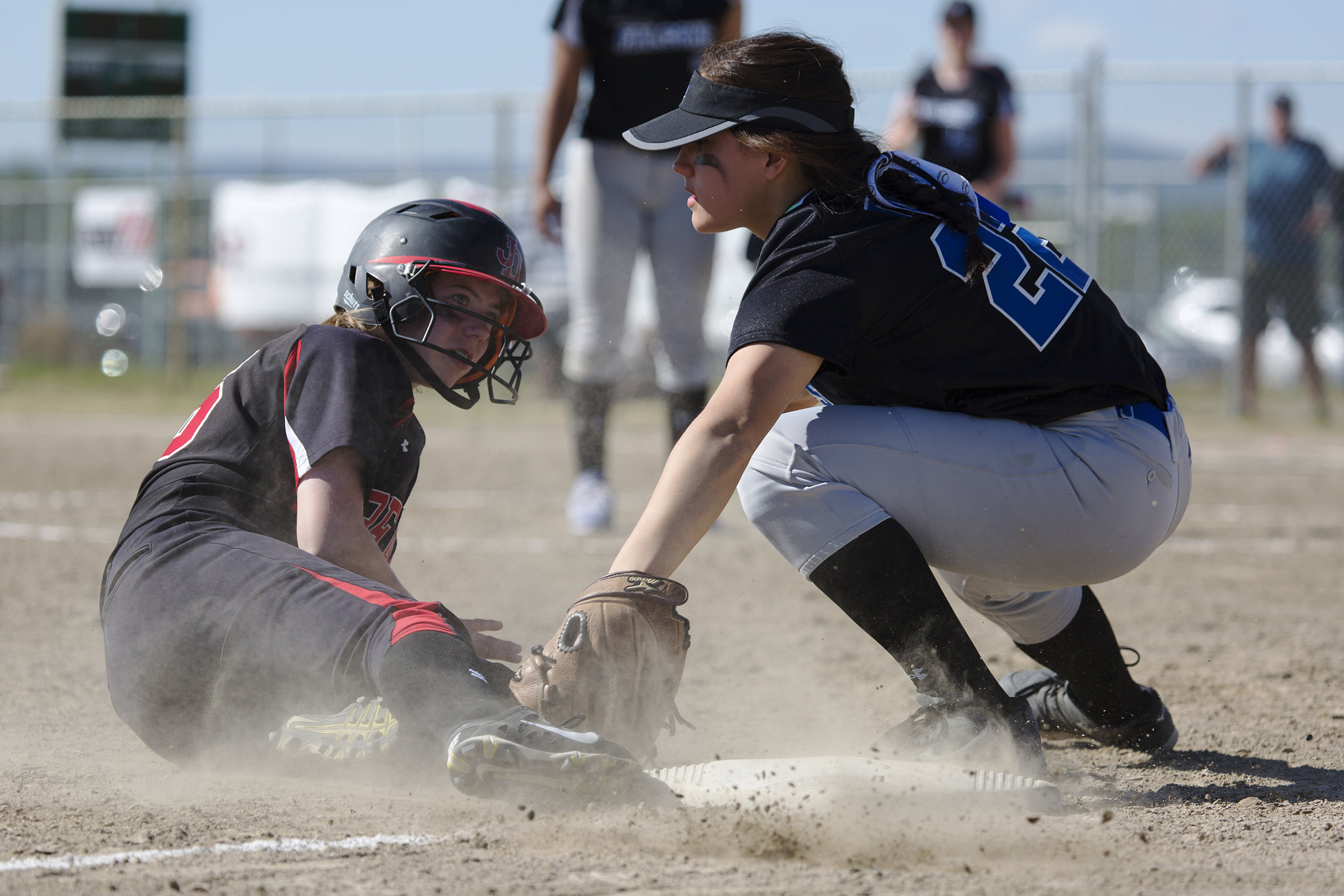 Juneau Douglas, Elisa Fabrello (2) (left) misses third base and is tagged out by Thunder Mountain, Alondra Echiverri (22) (right) who caught the ball moments before Fabrello slid onto the base in the finals for the State Championship Softball game on Saturday, June 3rd in the South Davis Park Complex in Fairbanks, AK. Sarah Manriquez/ Juneau Empire