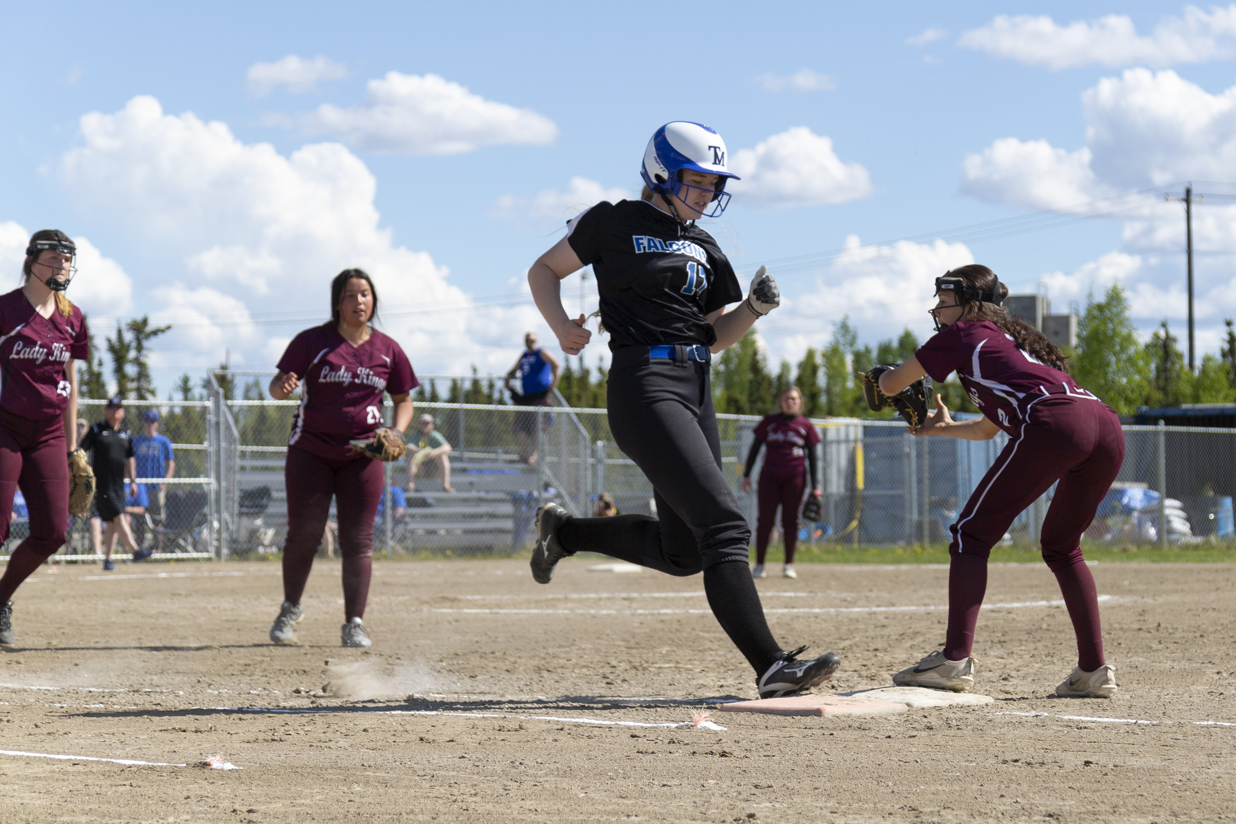 #30 Megan Dallas of Thunder Mountain High School makes it safely onto first base in the fourth inning of Thunder Mountain vs Ketchikan in the first Championship Game on Saturday, June 2nd in Fairbanks, AK. Sarah Manriquez/Juneau Empire