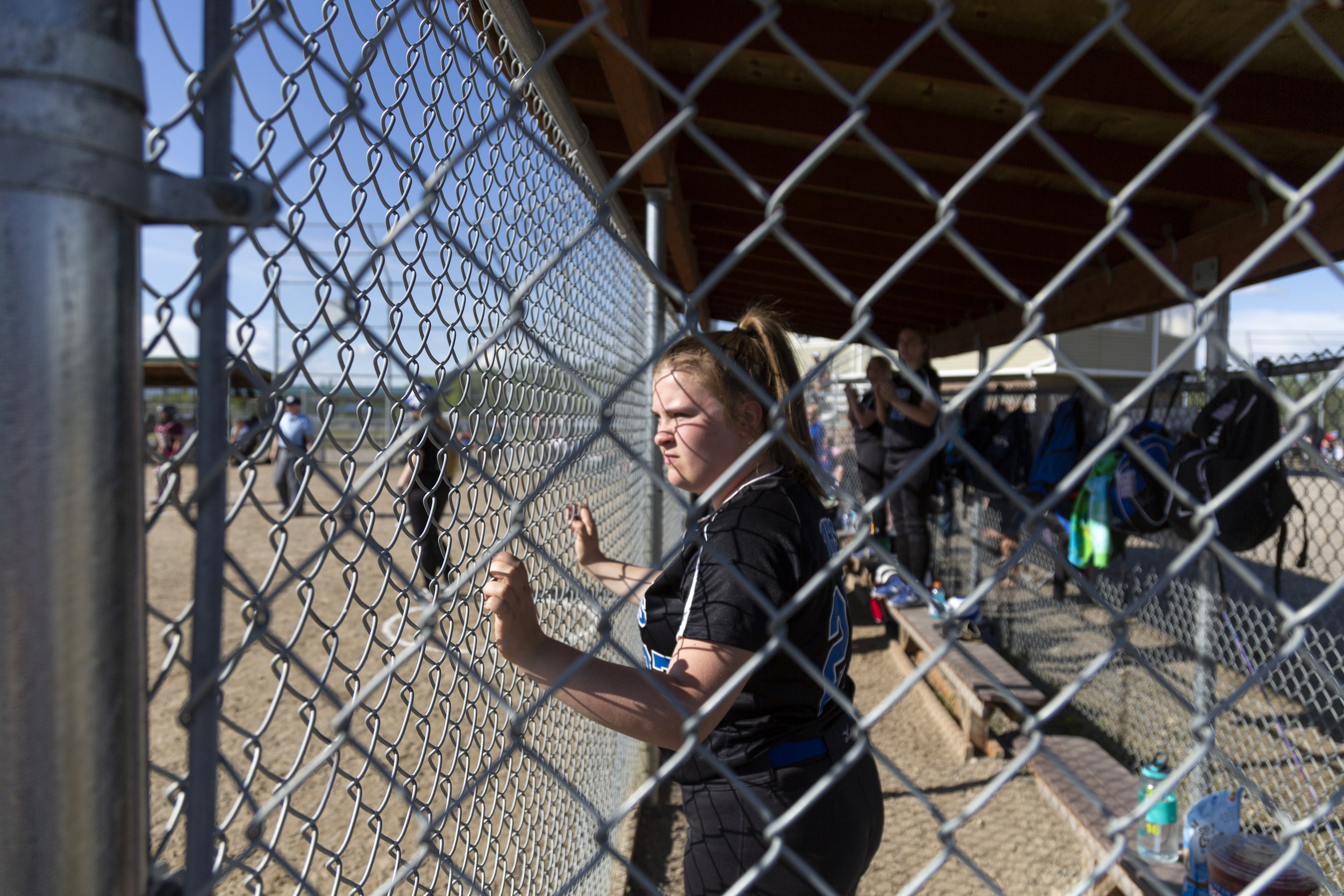 #27 Morgan Poole watches her teammates on the field in the Thunder Mountain vs Ketchikan double elimination championship game on Saturday, June 2nd in Fairbanks, AK. Sarah Manriquez/Juneau Empire