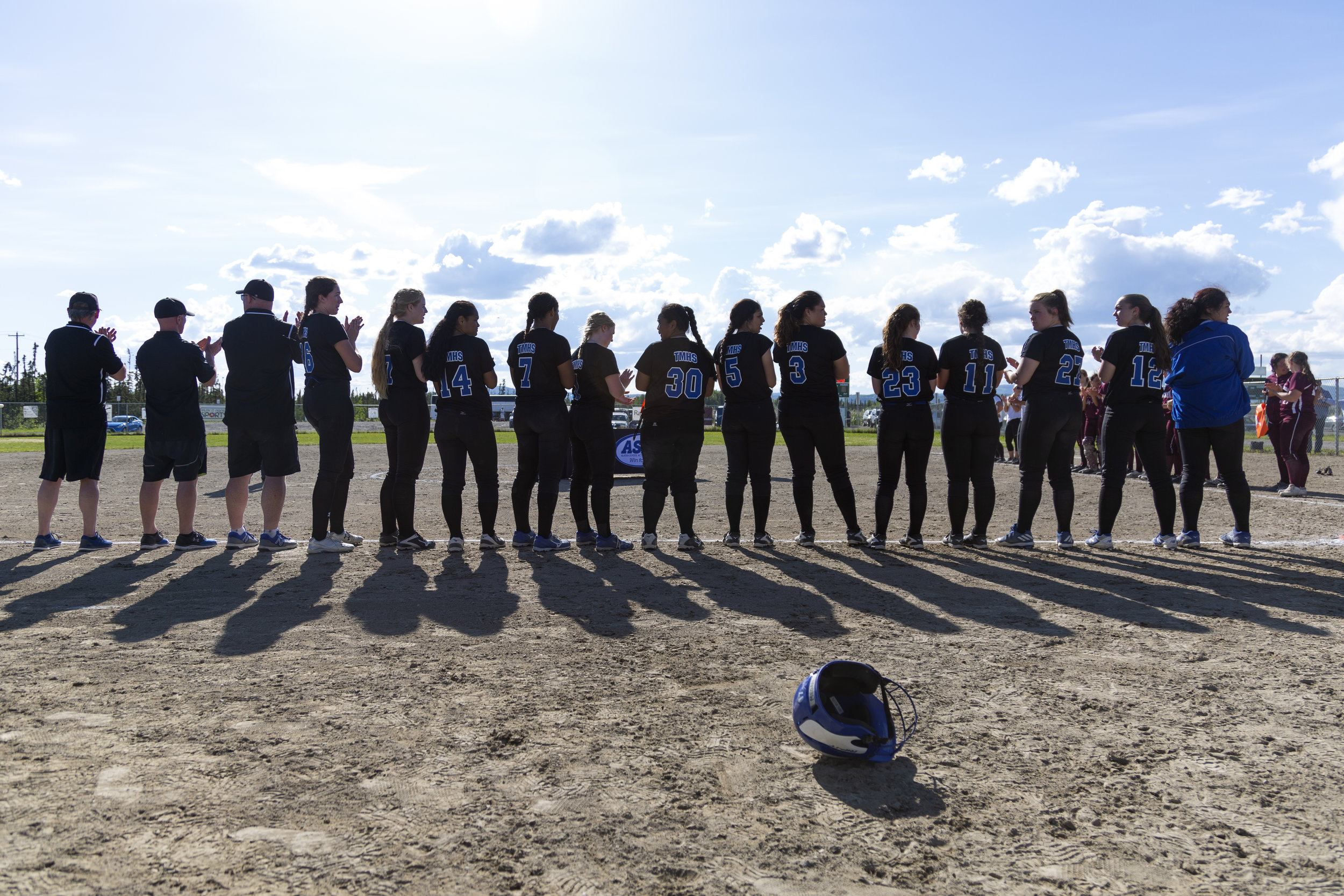 The Thunder Mountain Falcons softball team lines up for the award ceremony at the ASAA Division II state softball tournament in Fairbanks where they won the state championship for the third year in a row. Sarah Manriquez/Juneau Empire