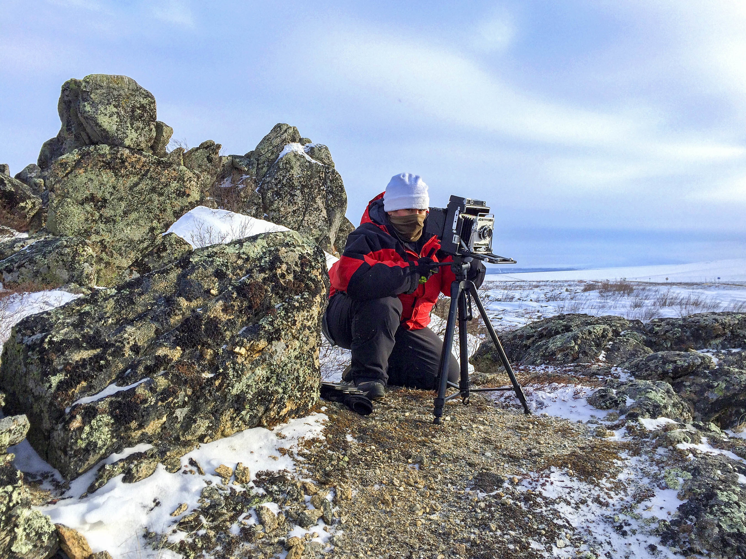 Kat Reichert, shoots a large format camera on the top of Finger Mountain off the Dalton Highway.
