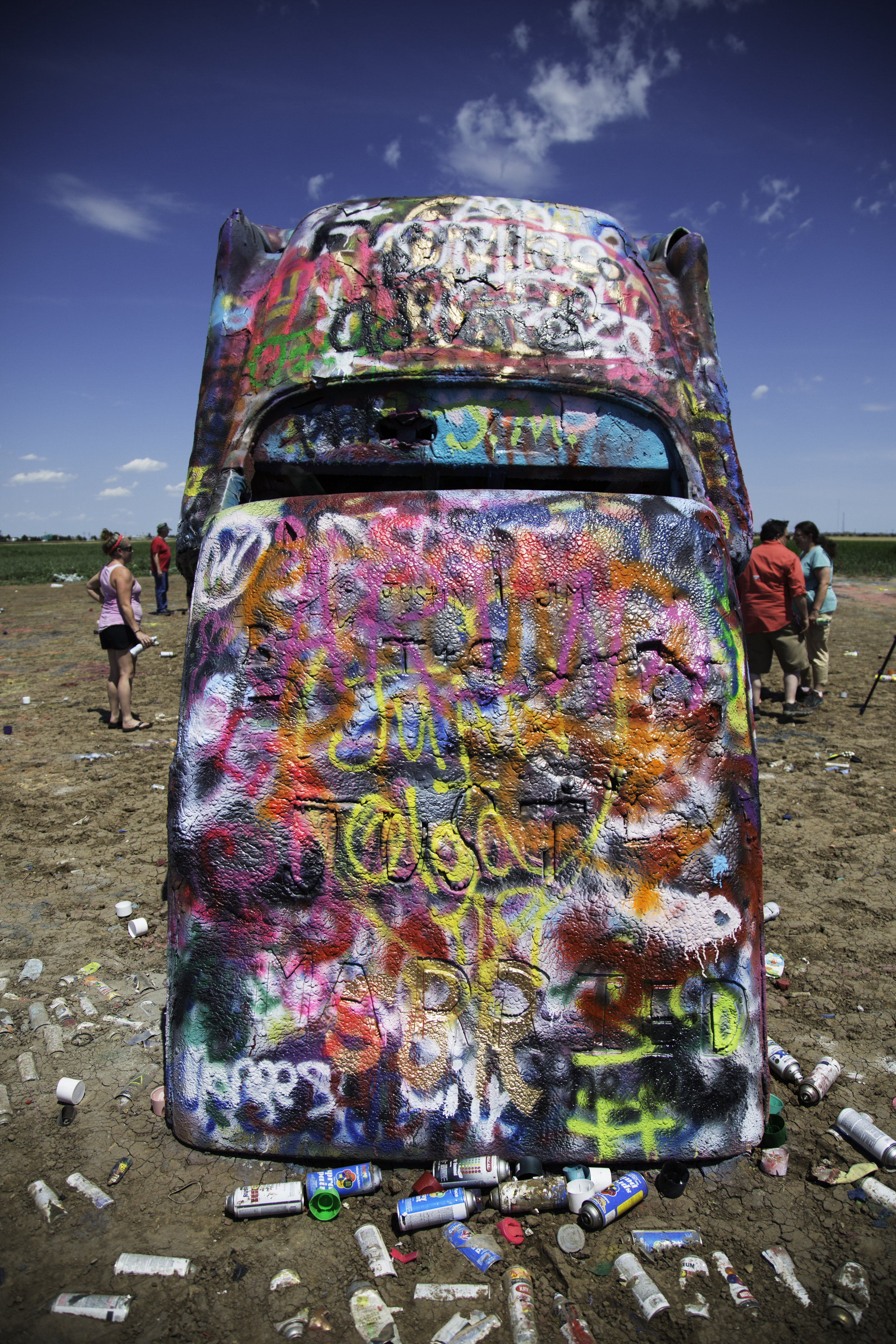 The Cadillac Ranch is visible from the highway, and even though it is technically located on private land, visiting it is highly encouraged. You can access the entrance by driving along a frontage road and entering the pasture by walking through an unlocked gate. The vehicles are wildly decorated and spray painted differently by hundreds of different people every single day.