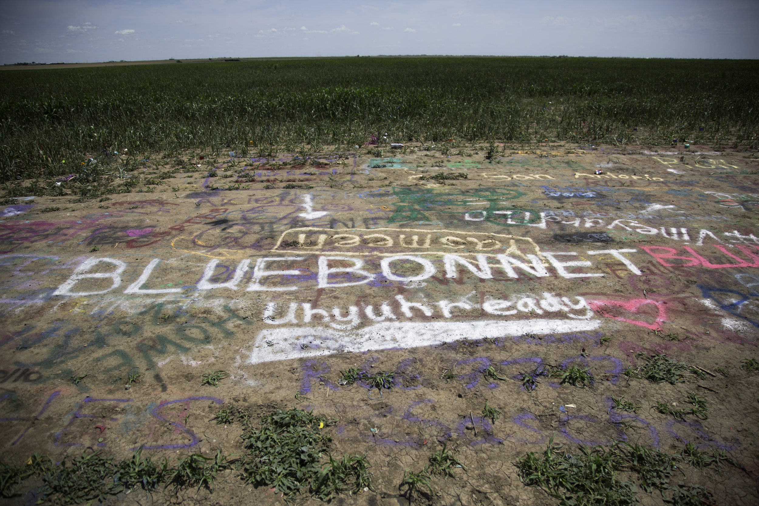 Spray paint on the ground at the Cadillac Ranch.