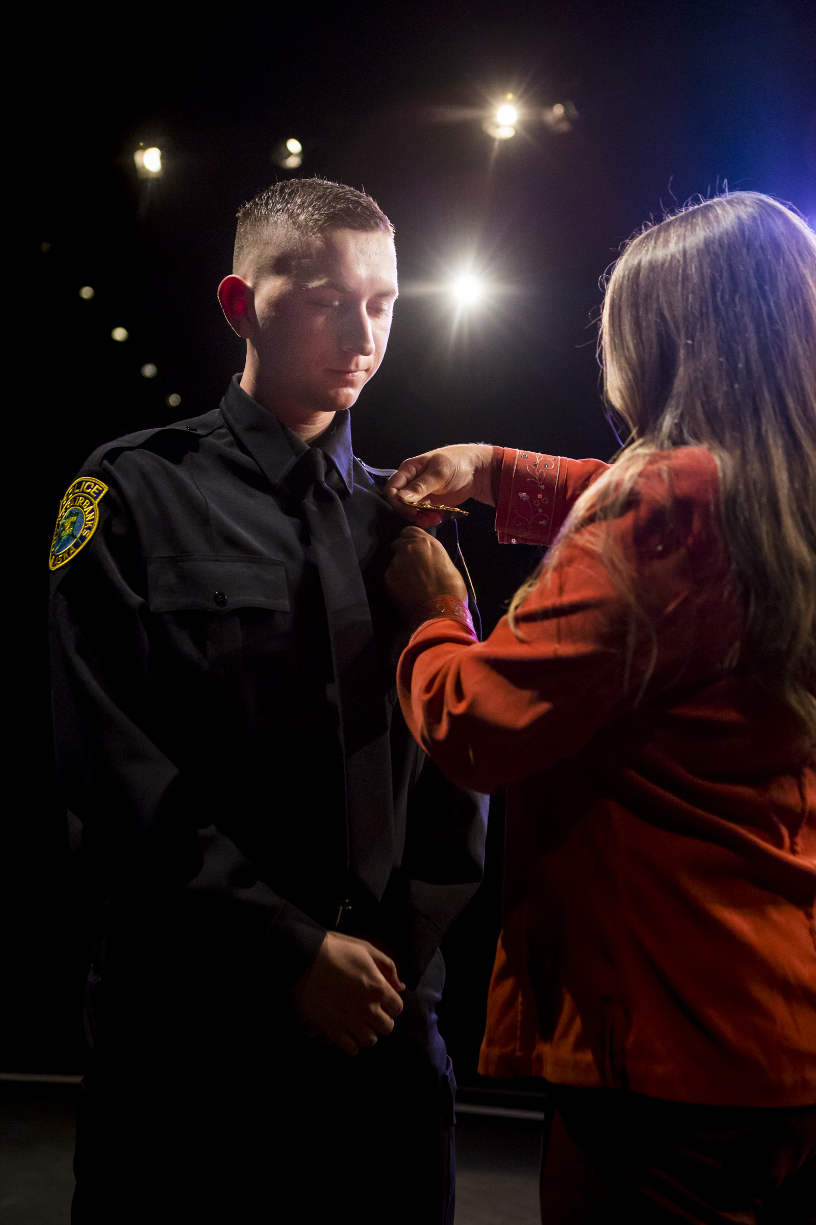 Christian Pergande his badge during the pinning ceremony at the Community and Technical College Police Academy graduation on Friday, October 12th, 2018.