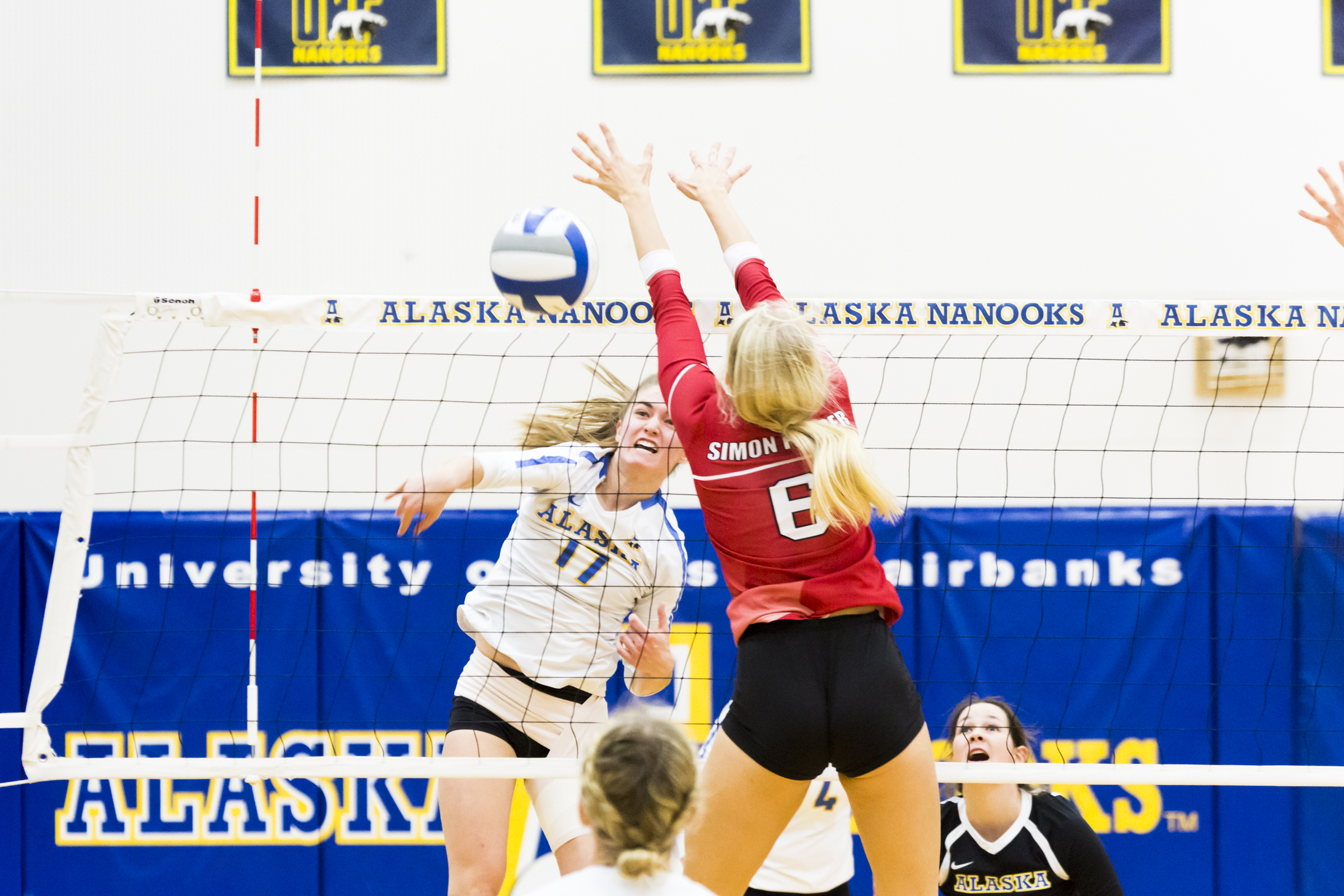 #17 Cate Whiting spikes the ball and scores a point on Thursday, October 18th 2018 UAF vs Simon Fraser University.