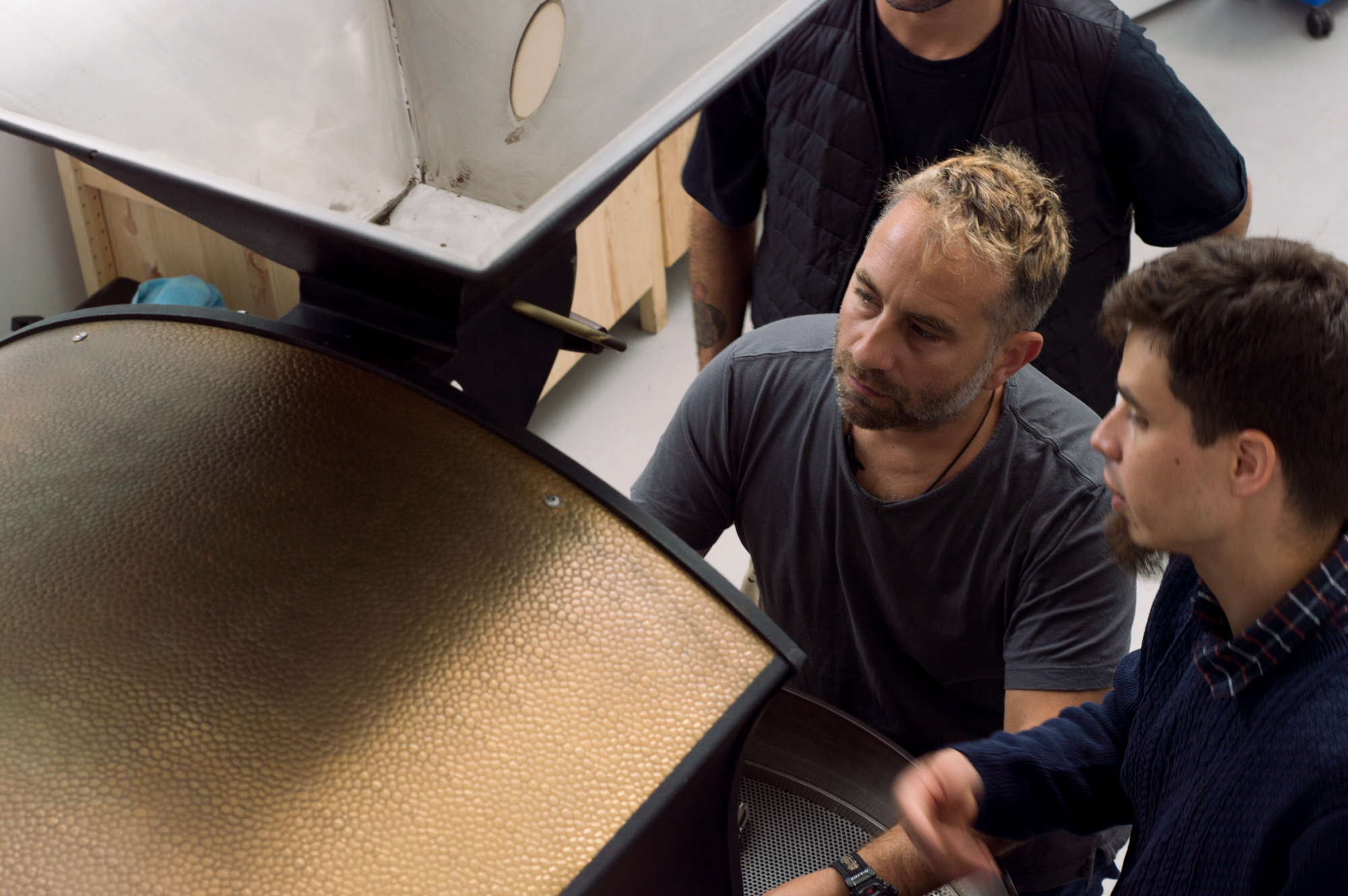 Director Edy Piro and Head roaster, Julian configuring the machine.