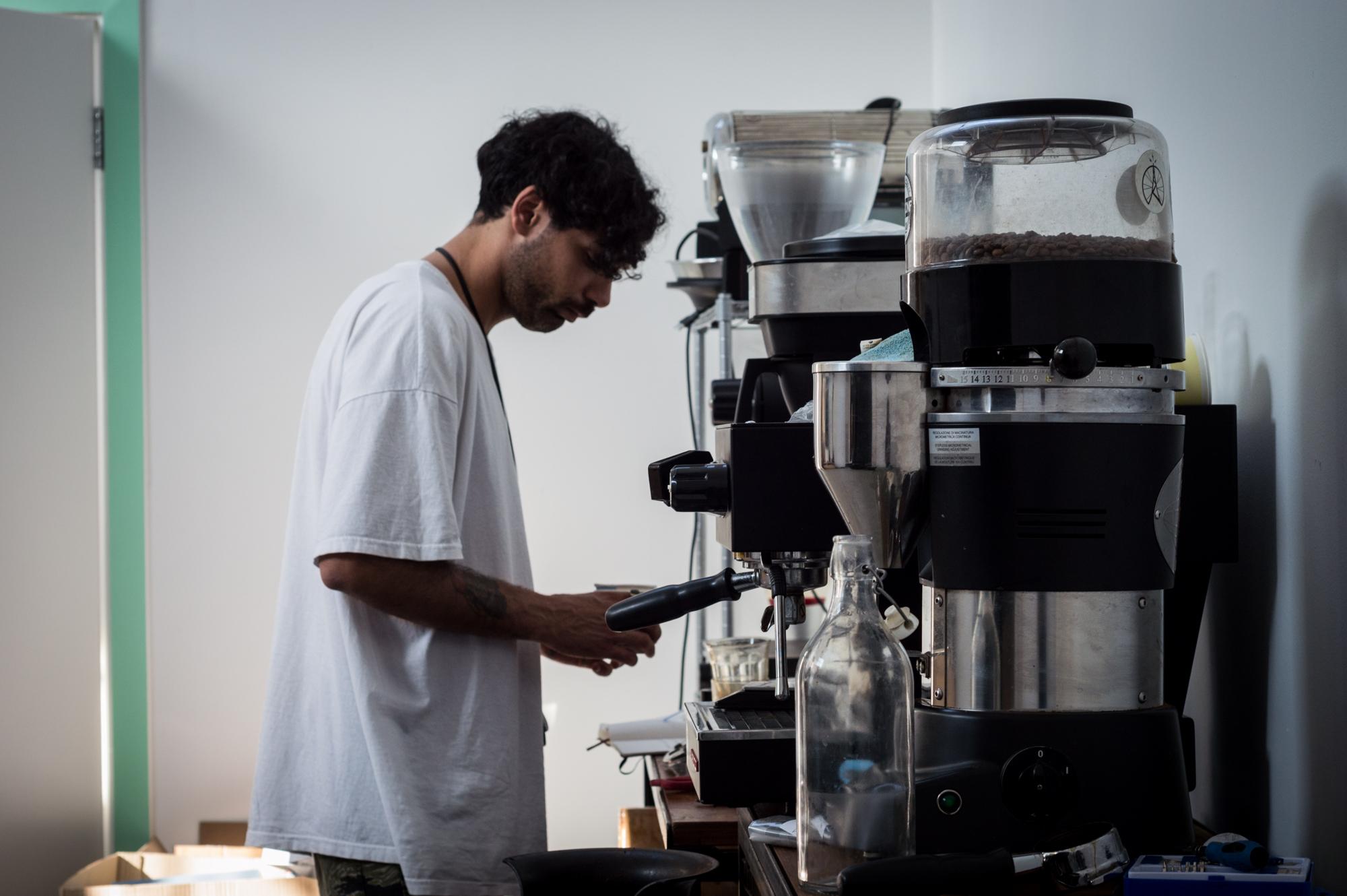 Wholesale manager, Leonardo Leoncini pulling espresso from freshly roasted beans on our La Marzocco Linea Mini.