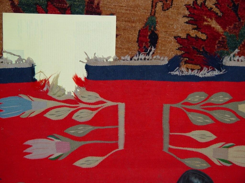 Kilim rug with a damaged edge