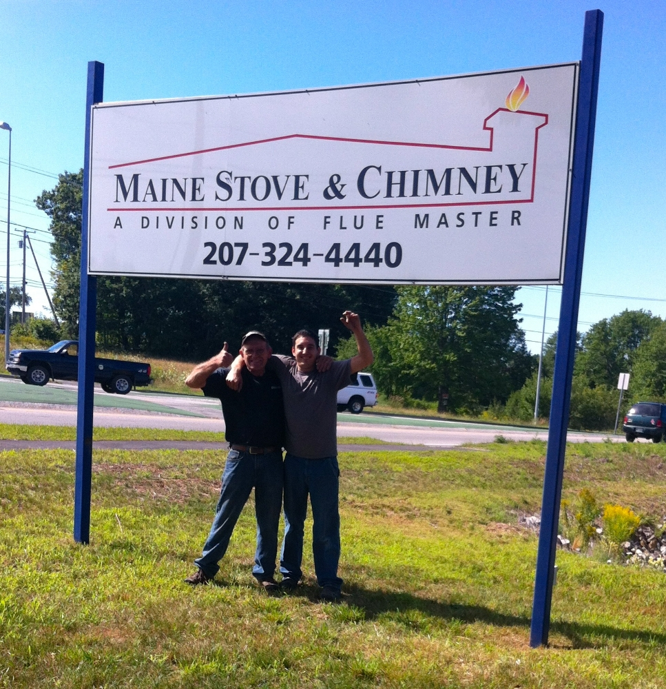 Doug & JJ under the sign on opening day of our new Sanford location: 8/10/12