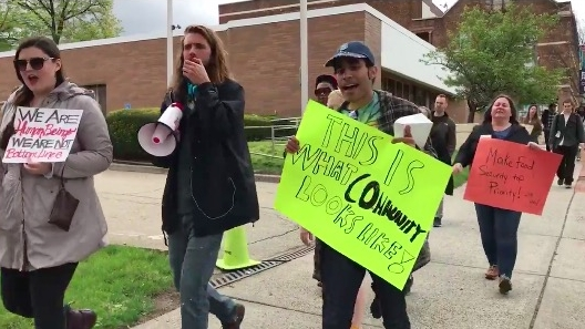 Organizer and community activist, Dan Cruz, (Right) leads protestors down Bloomfield Ave to raise awareness about food insecurity in Montclair, NJ
